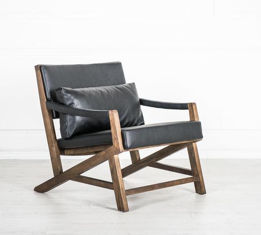 Duzzle poltrona vintage nera con gambe in legno flow fusion desing lato