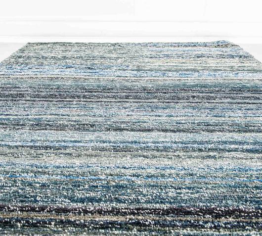 Duzzle tappeto colore azzurro fatto a mano stones