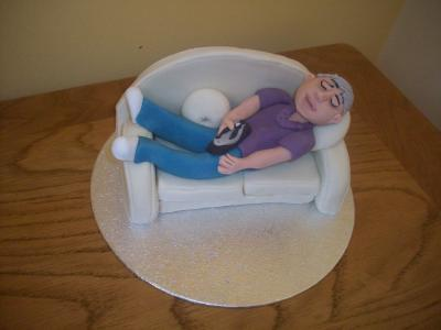Man relaxing with TV Remote Cake Topper