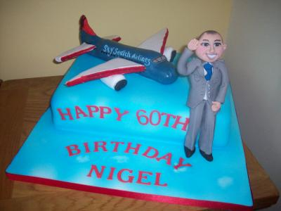 Man and Passenger Jet Cake