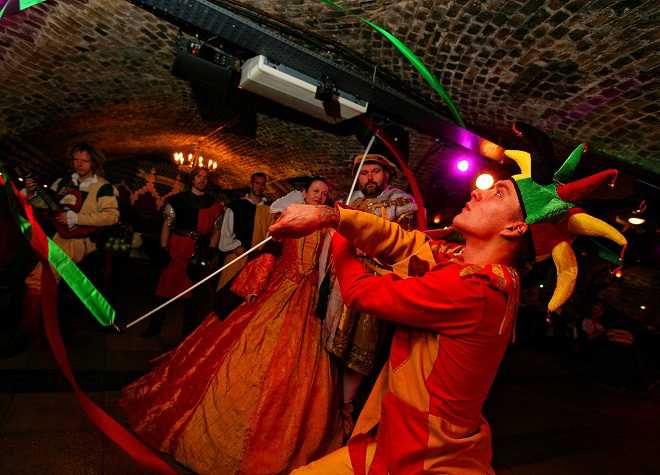 Medieval Banquet Jester Performing