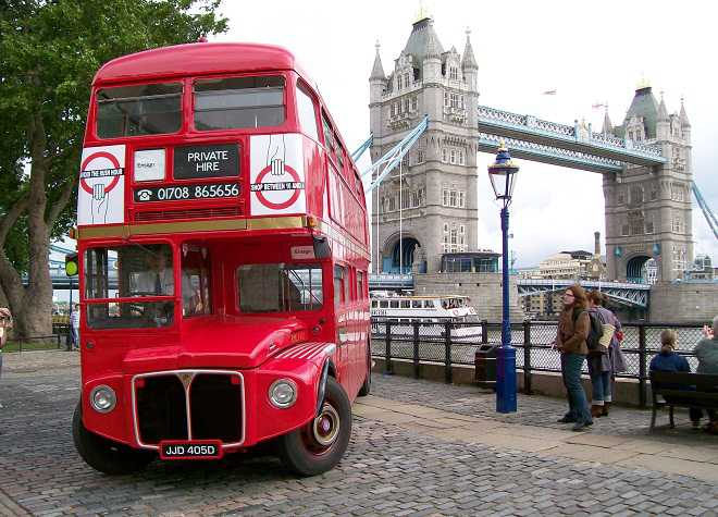 Vintage Red Bus in front of Tower Bridge