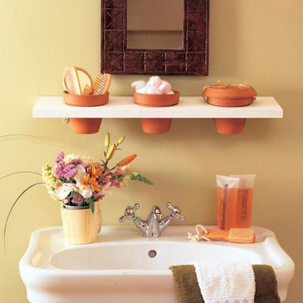23 alternative uses for terracotta flower pots storage for Pot shelf decorating ideas