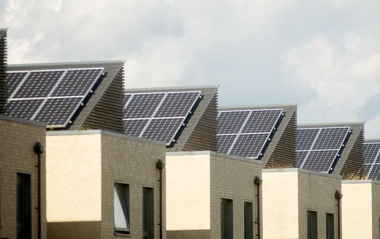 Solar powered roofing on top of a residential development