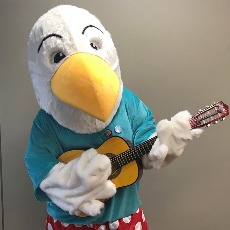 Sonny the Music on Sea mascot playing guitar