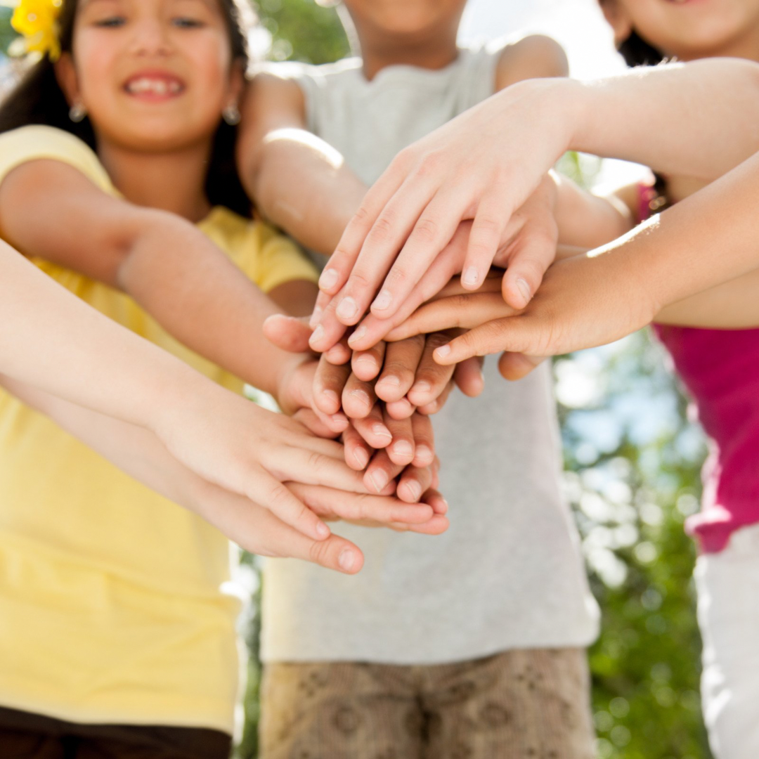 Close up of children's hands one over another