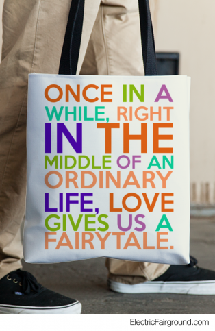 Once in a while, RIGHT IN THE MIDDLE of an ORDINARY life, Love gives us a FAIRYTALE. Tote Bag