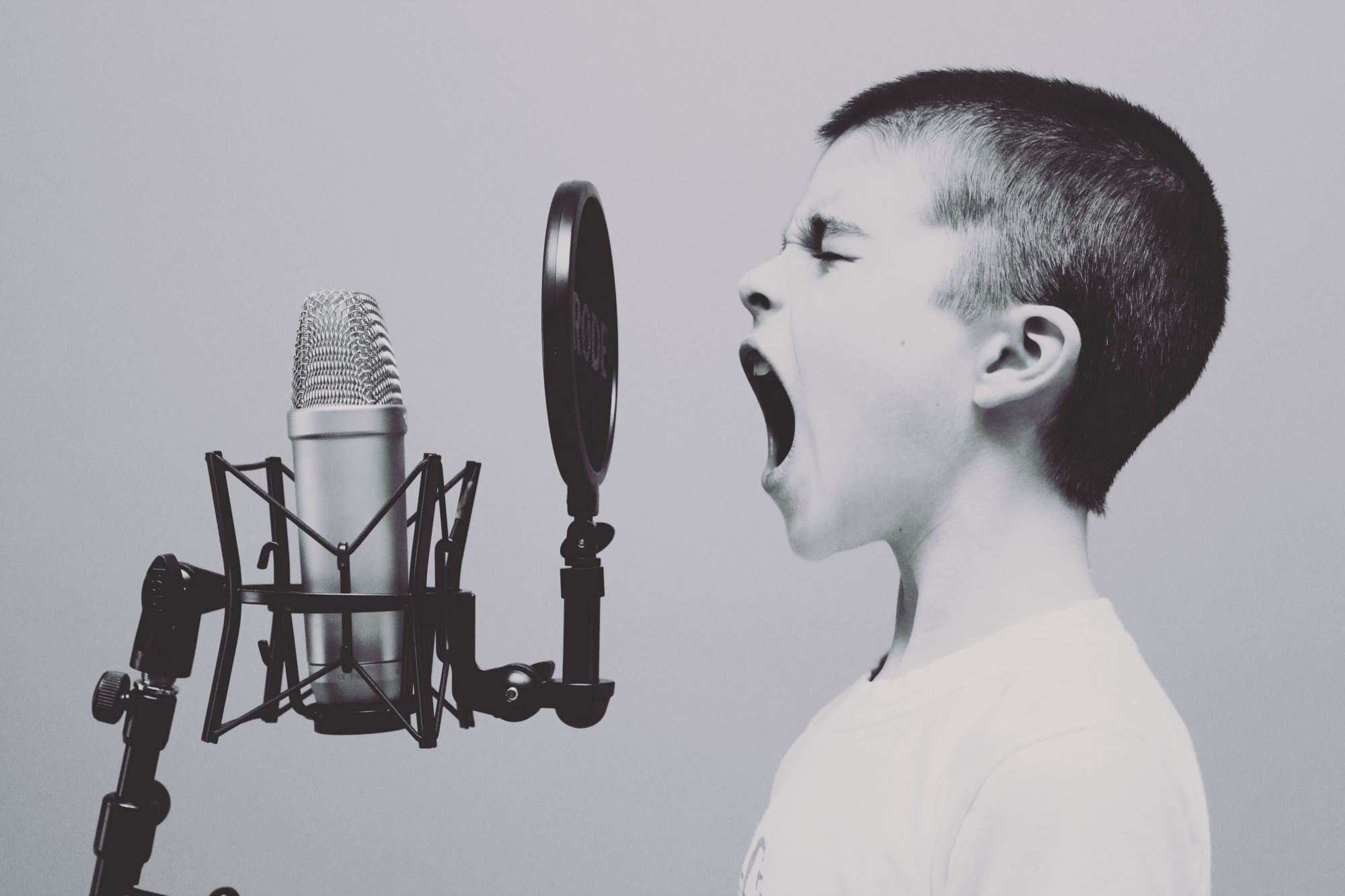 Boy singing into a microphone