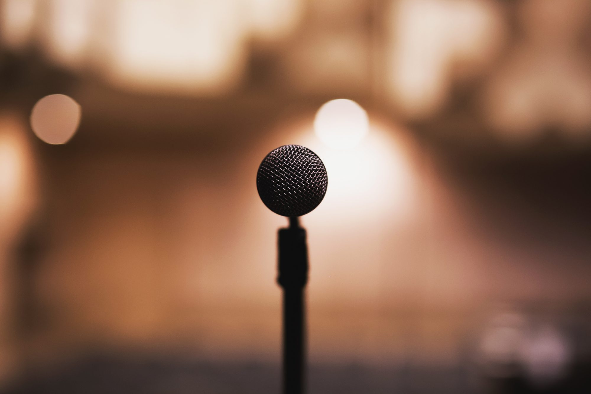 Freestanding black vocal recorder standing on a stage
