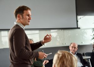 Male speaker engaging with audience at training conference