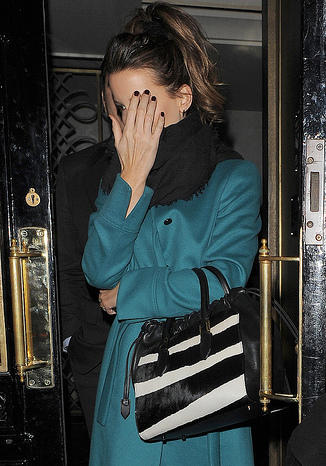 Kate Beckinsale appears rather camera-shy