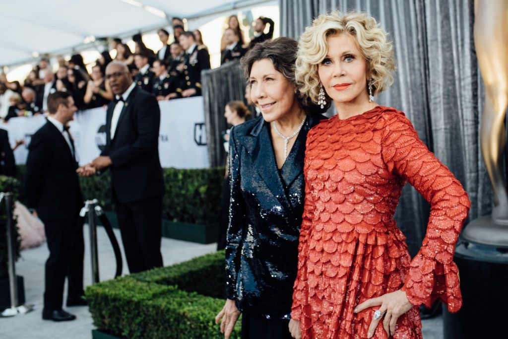LOS ANGELES, CALIFORNIA - JANUARY 27:  (EDITORS NOTE: Image has been edited using a digital filter) Lily Tomlin (L) and Jane Fonda arrive at the 25th annual Screen Actors Guild Awards at The Shrine Auditorium on January 27, 2019 in Los Angeles, California. (Photo by Emma McIntyre/Getty Images for Turner)