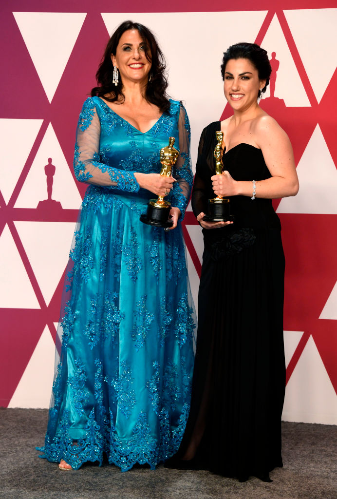 "HOLLYWOOD, CALIFORNIA - FEBRUARY 24: (L-R) Melissa Berton and Rayka Zehtabchi, winners of Best Documentary Short Subject for ""Period. End of Sentence.,"" pose in the press room during the 91st Annual Academy Awards at Hollywood and Highland on February 24, 2019 in Hollywood, California. (Photo by Frazer Harrison/Getty Images)"