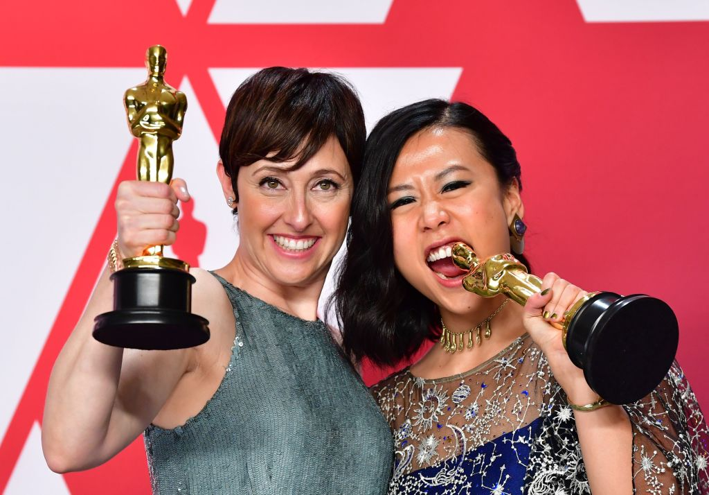 "Best Animated Short Film winners for ""Bao"" Domee Shi (R) and Becky Neiman-Cobb pose in the press room with their Oscars during the 91st Annual Academy Awards at the Dolby Theatre in Hollywood, California on February 24, 2019. (Photo by FREDERIC J. BROWN / AFP)        (Photo credit should read FREDERIC J. BROWN/AFP/Getty Images)"