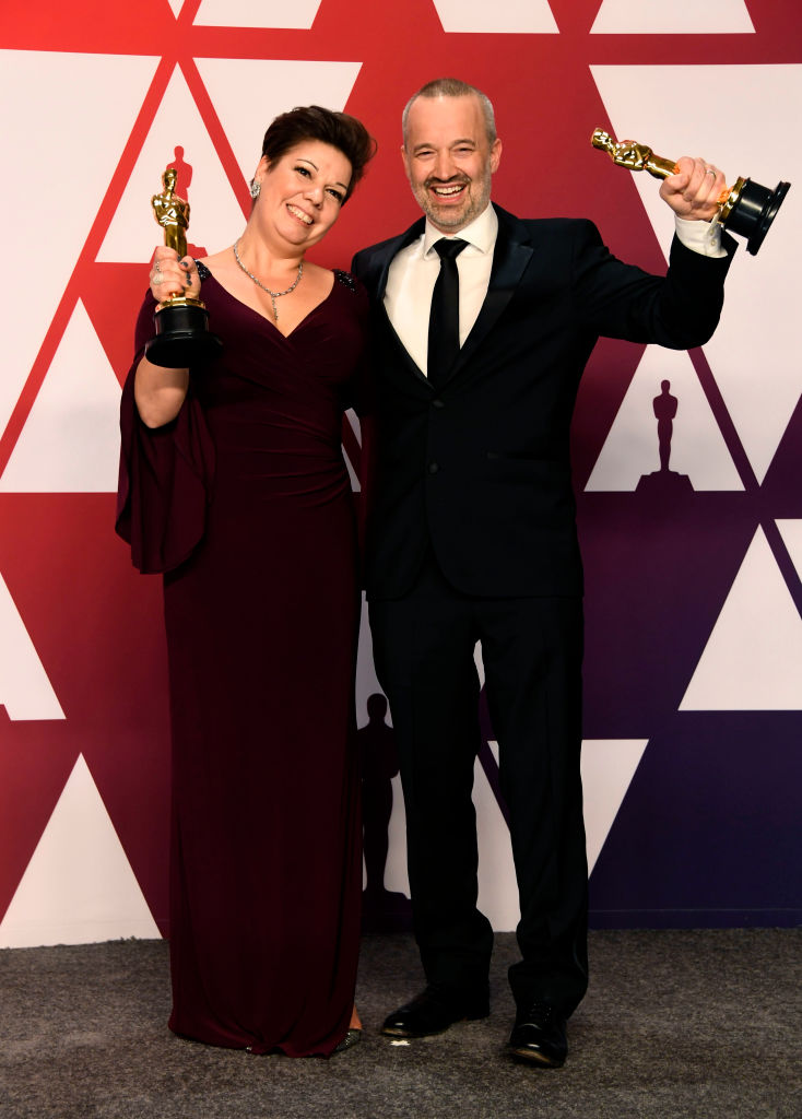"HOLLYWOOD, CALIFORNIA - FEBRUARY 24: (L-R) Nina Hartstone and John Warhurst, winners of Best Sound Editing for ""Bohemian Rhapsody,"" pose in the press room during the 91st Annual Academy Awards at Hollywood and Highland on February 24, 2019 in Hollywood, California. (Photo by Frazer Harrison/Getty Images)"