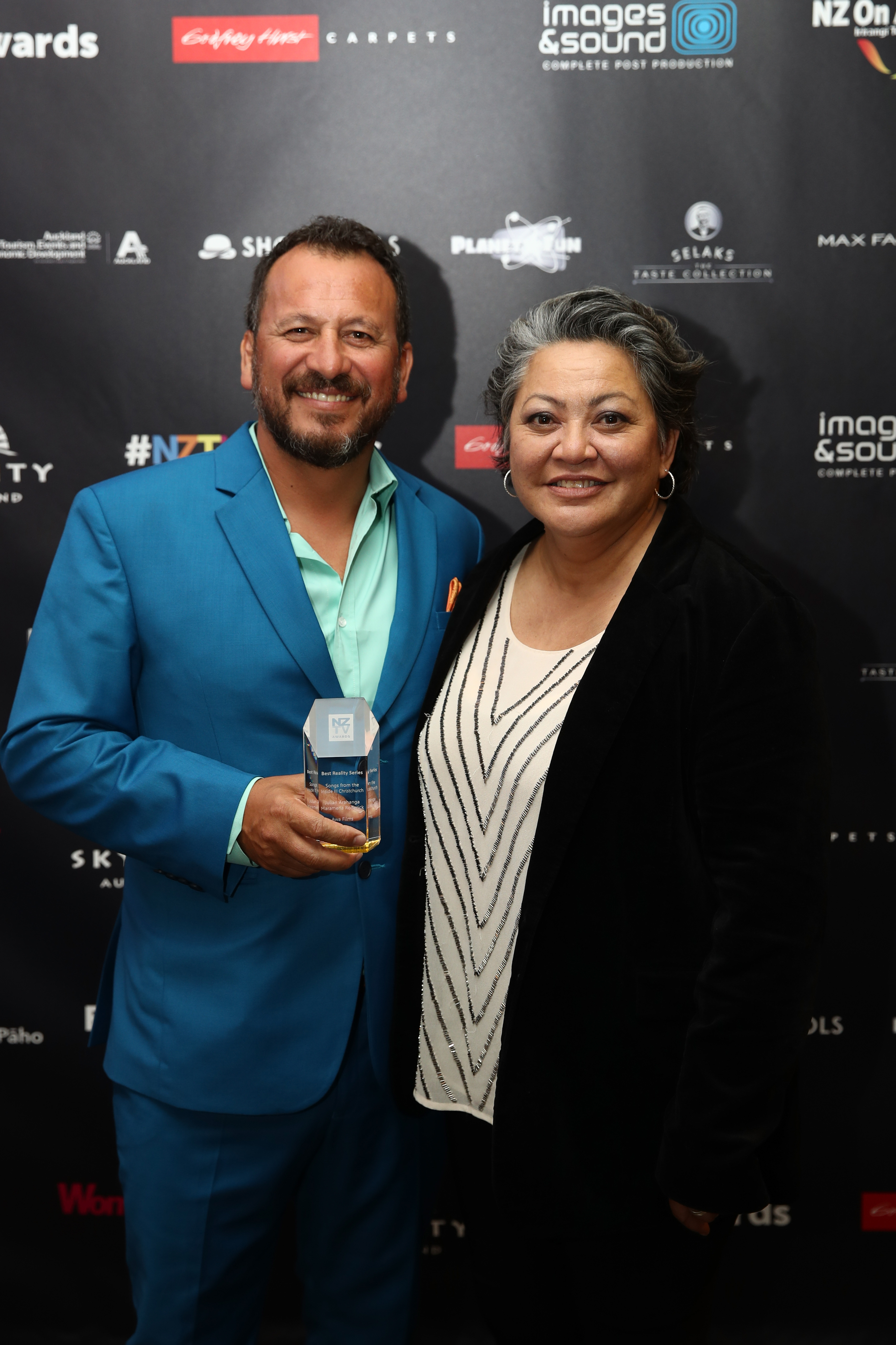 Julian Arahanga and Maramena Roderick with the award for Best Reality Series during the NZ TV Awards at Sky City on November 30, 2017 in Auckland, New Zealand.  (Photo by Phil Walter/Getty Images)