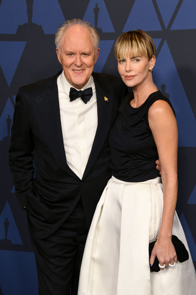 John Lithgow and Charlize Theron attend the Academy Of Motion Picture Arts And Sciences' 11th Annual Governors Awards at The Ray Dolby Ballroom at Hollywood & Highland Center in Hollywood, California. (Photo by Kevin Winter/Getty Images)