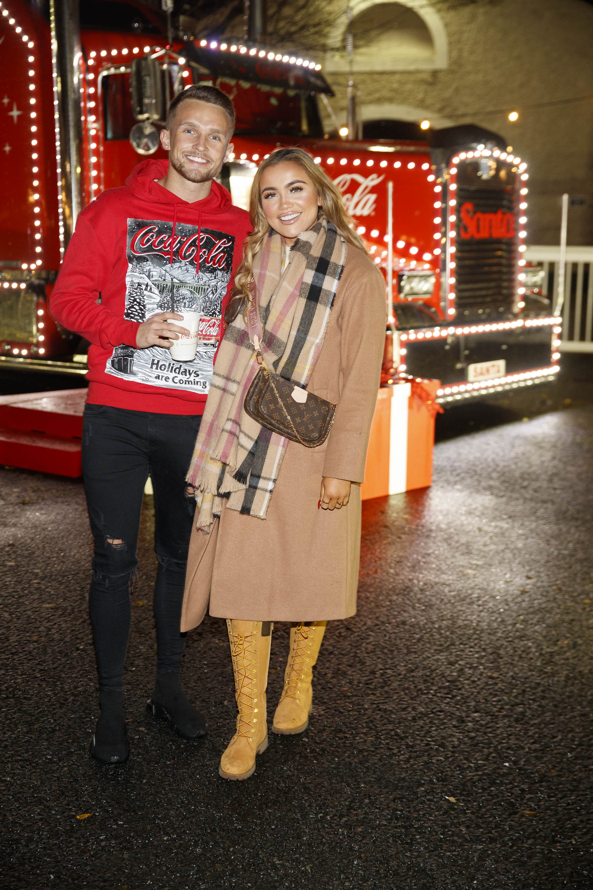 Ellie Kelly and Conor Ryan pictured at Coca-Cola's Christmas Truck Tour launch which took place Monday 25th November at the RDS, Dublin. Photo: Andres Poveda