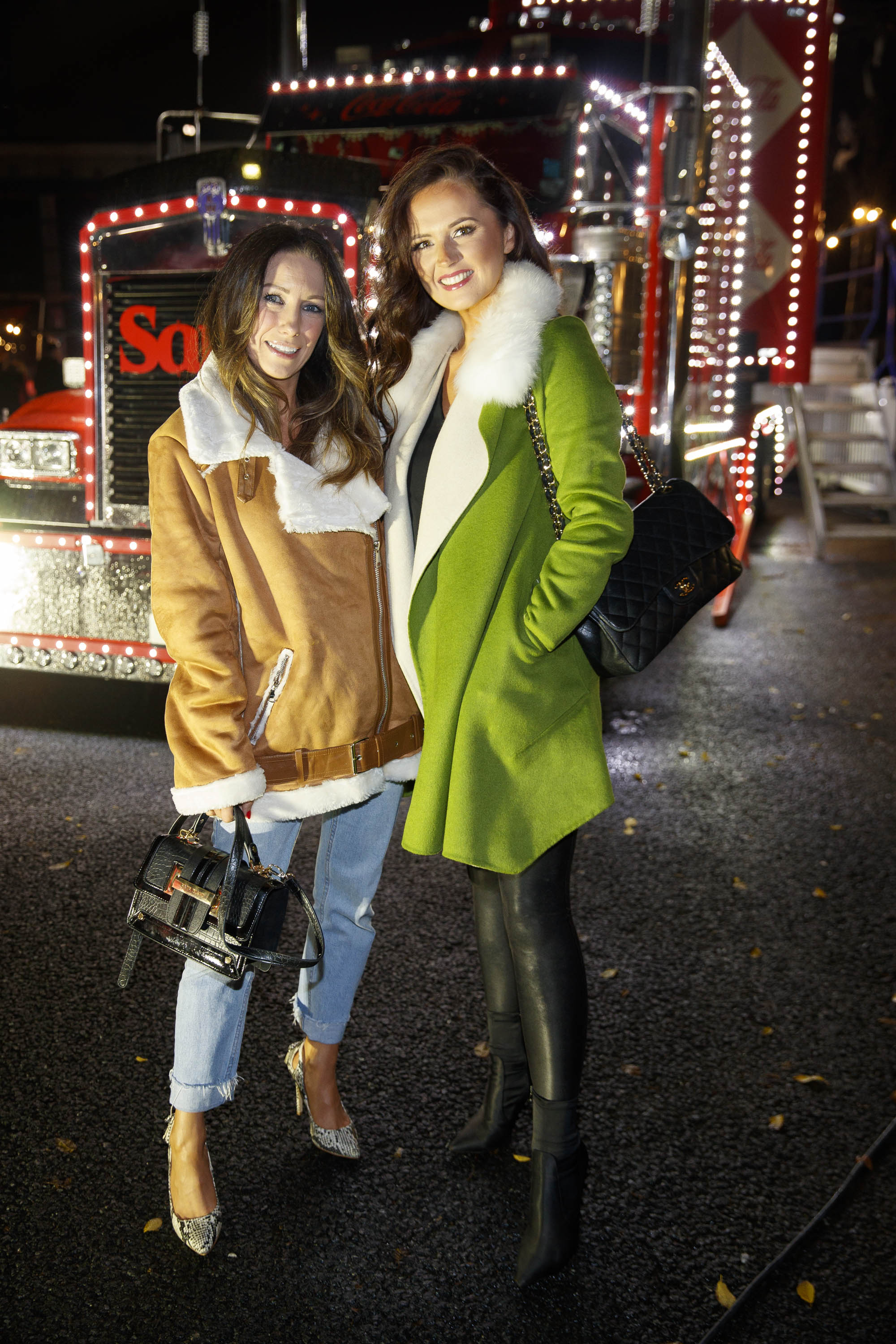 Claire Tenwick and Jennifer Wrynne pictured at Coca-Cola's Christmas Truck Tour launch which took place Monday 25th November at the RDS, Dublin. Photo: Andres Poveda