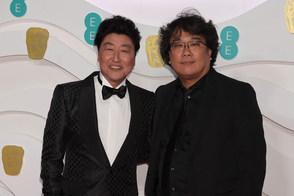 Song Kang-Ho and Bong Joon-ho arrive at the EE British Academy Film Awards 2020 at Royal Albert Hall on February 2, 2020 in London, England. (Photo by David M. Benett/Dave Benett/Getty Images)