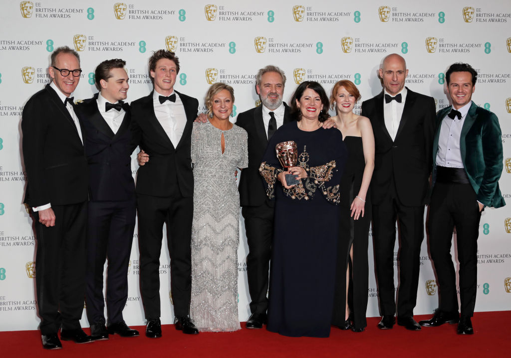 "(L to R)  Callum McDougall, Dean-Charles Chapman, George MacKay, Jayne-Ann Tenggren, Sir Sam Mendes, Dame Pippa Harris, Krysty Wilson-Cairns, Mark Strong and Andrew Scott, accepting the Best Film award for ""1917"", pose in the Winners Room at the EE British Academy Film Awards 2020 at Royal Albert Hall on February 2, 2020 in London, England. (Photo by David M. Benett/Dave Benett/Getty Images)"