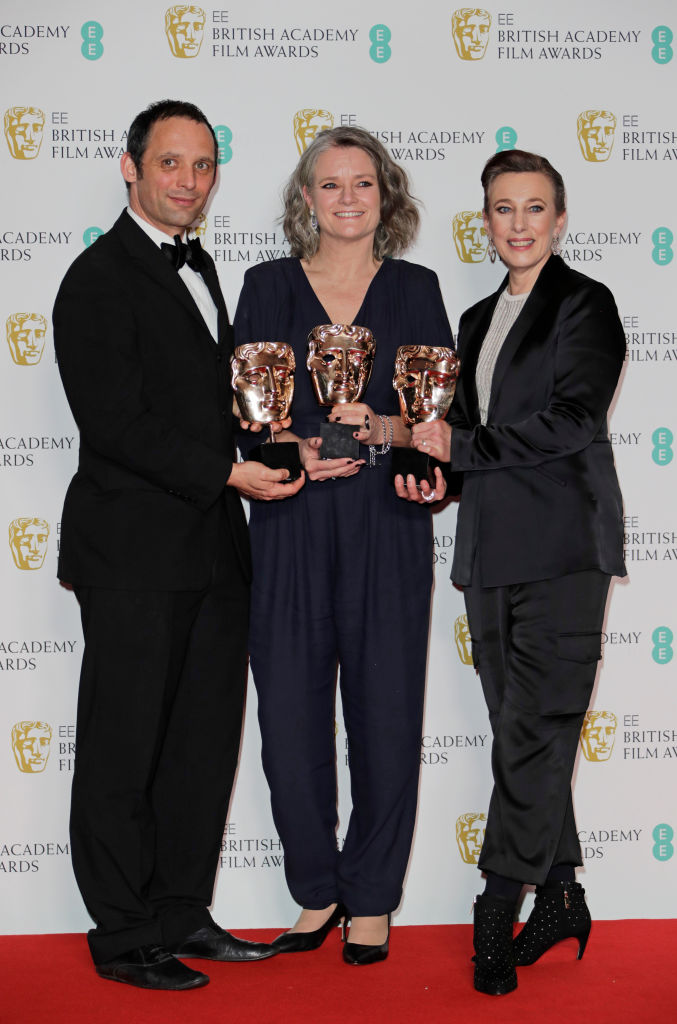 "(L to R)  Mark Jenkin, Linn Waite and Kate Byers, winners of Outstanding Debut By A British Writer, Director or Producer for ""Bait"", pose in the Winners Room at the EE British Academy Film Awards 2020 at Royal Albert Hall on February 2, 2020 in London, England. (Photo by David M. Benett/Dave Benett/Getty Images)"
