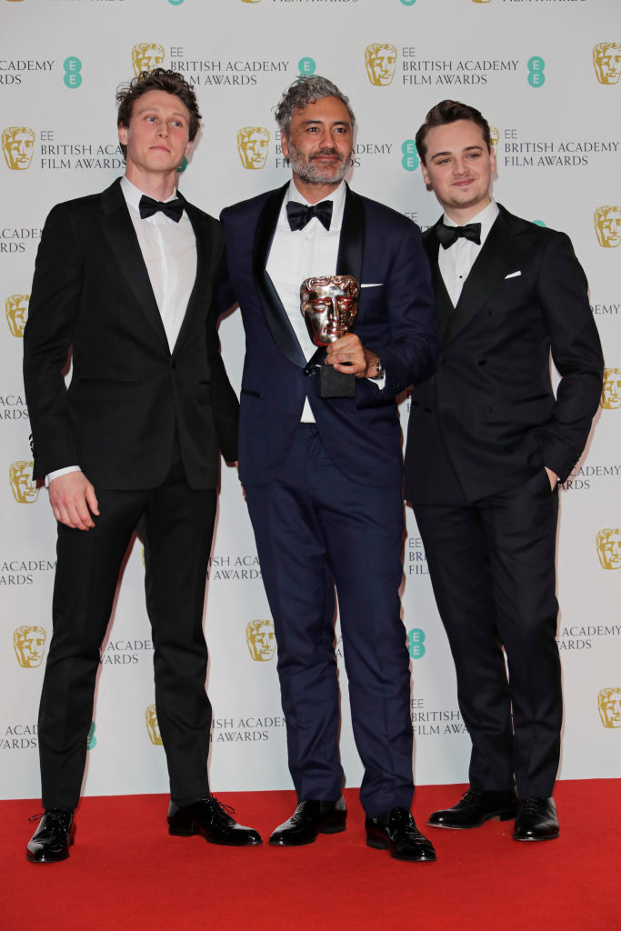 "(L to R)  George MacKay, Taika Waititi, winner of the Best Adapted Screenplay award for ""Jojo Rabbit"", and Dean-Charles Chapman pose in the Winners Room at the EE British Academy Film Awards 2020 at Royal Albert Hall on February 2, 2020 in London, England. (Photo by David M. Benett/Dave Benett/Getty Images)"