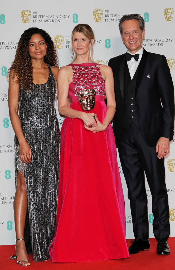 "(L to R)  Naomie Harris, Laura Dern, winner of Best Supporting Actress for ""Marriage Story"", and Richard E. Grant pose in the Winners Room at the EE British Academy Film Awards 2020 at Royal Albert Hall on February 2, 2020 in London, England. (Photo by David M. Benett/Dave Benett/Getty Images)"
