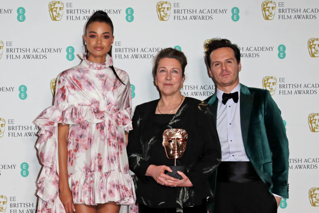 "Ella Balinska, Jacqueline Durran, winner of Best Costume Design for ""Little Women"", and Andrew Scott pose in the Winners Room at the EE British Academy Film Awards 2020 at Royal Albert Hall on February 2, 2020 in London, England. (Photo by David M. Benett/Dave Benett/Getty Images)"