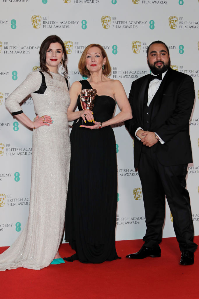 "(L to R)  Aisling Bea, Anne Morgan, winner of Best Make-Up and Hair for ""Bombshell"", and Asim Chaudhry aka Chabuddy G pose in the Winners Room at the EE British Academy Film Awards 2020 at Royal Albert Hall on February 2, 2020 in London, England. (Photo by David M. Benett/Dave Benett/Getty Images)"