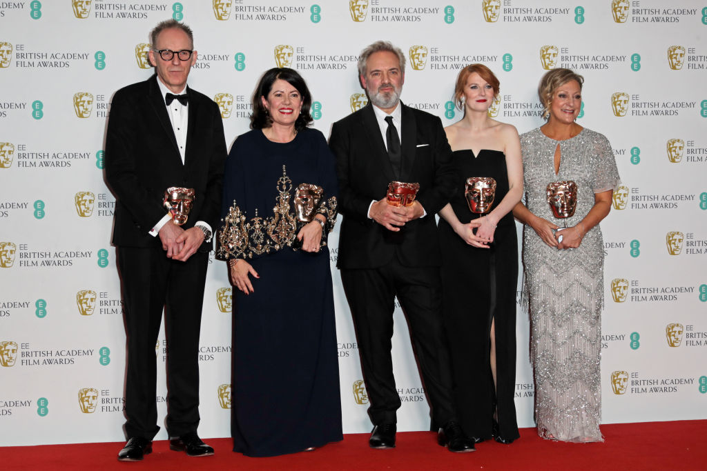 "(L to R)  Callum McDougall, Dame Pippa Harris, Sir Sam Mendes, Krysty Wilson-Cairns and Jayne-Ann Tenggren, winners of the Outstanding British Film award for ""1917"", pose in the Winners Room at the EE British Academy Film Awards 2020 at Royal Albert Hall on February 2, 2020 in London, England. (Photo by David M. Benett/Dave Benett/Getty Images)"
