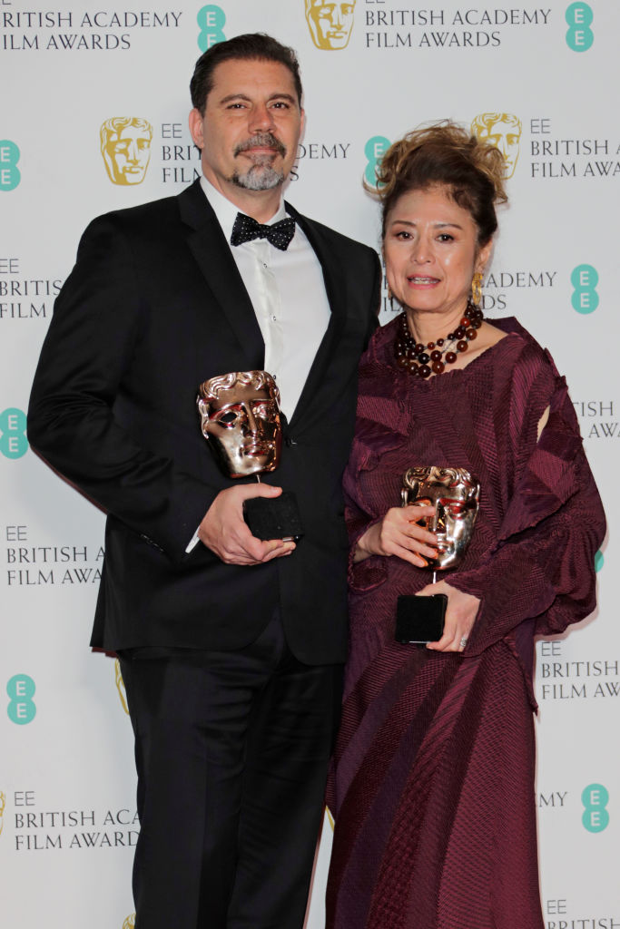 "Sergio Pablos and Jinko Gotoh, winners of the Best Animation award for ""Klaus"", pose in the Winners Room at the EE British Academy Film Awards 2020 at Royal Albert Hall on February 2, 2020 in London, England. (Photo by David M. Benett/Dave Benett/Getty Images)"