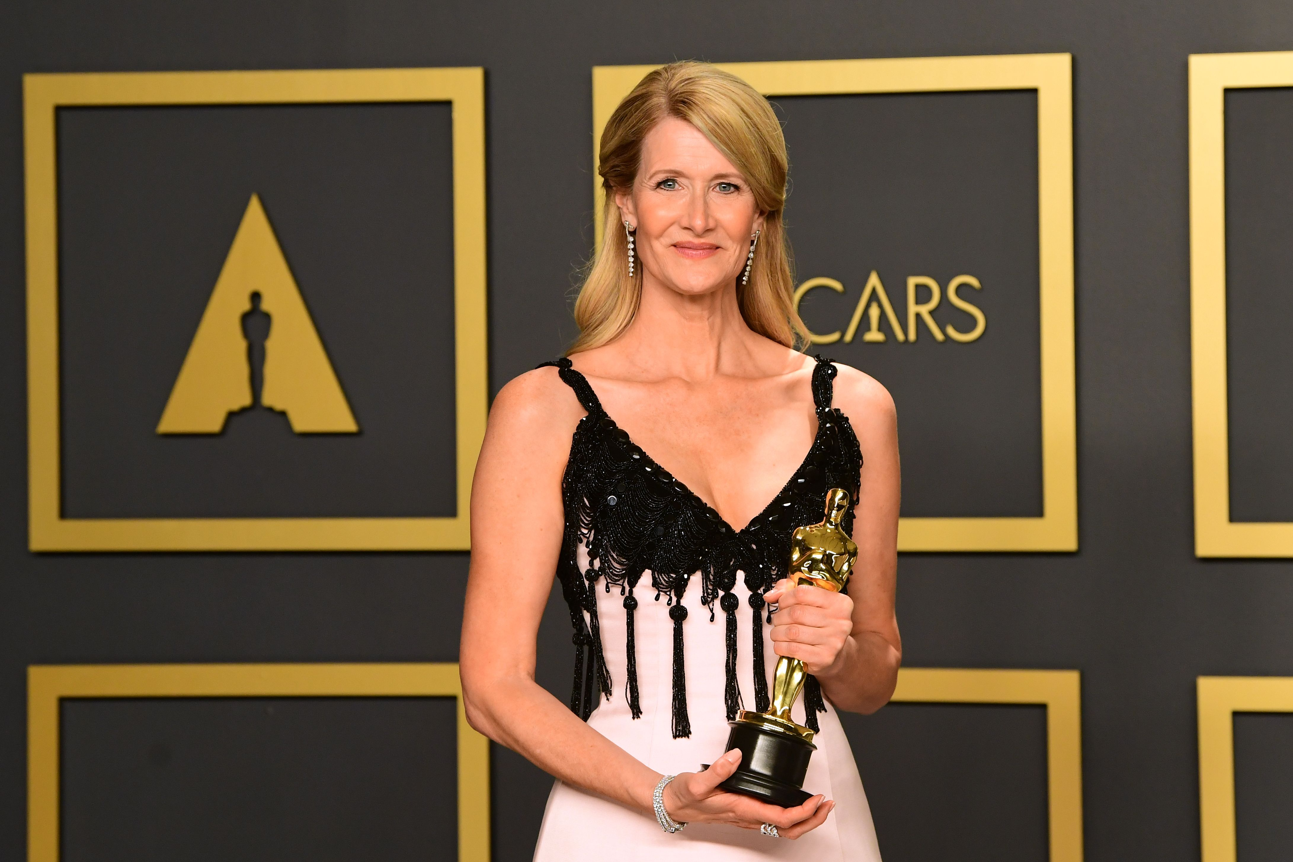 """US actress Laura Dern poses with the award for Best Actress in a Supporting Role for """"Marriage Story"""" in the press room during the 92nd Oscars at the Dolby Theater in Hollywood, California on February 9, 2020. (Photo by FREDERIC J. BROWN / AFP) (Photo by FREDERIC J. BROWN/AFP via Getty Images)"""