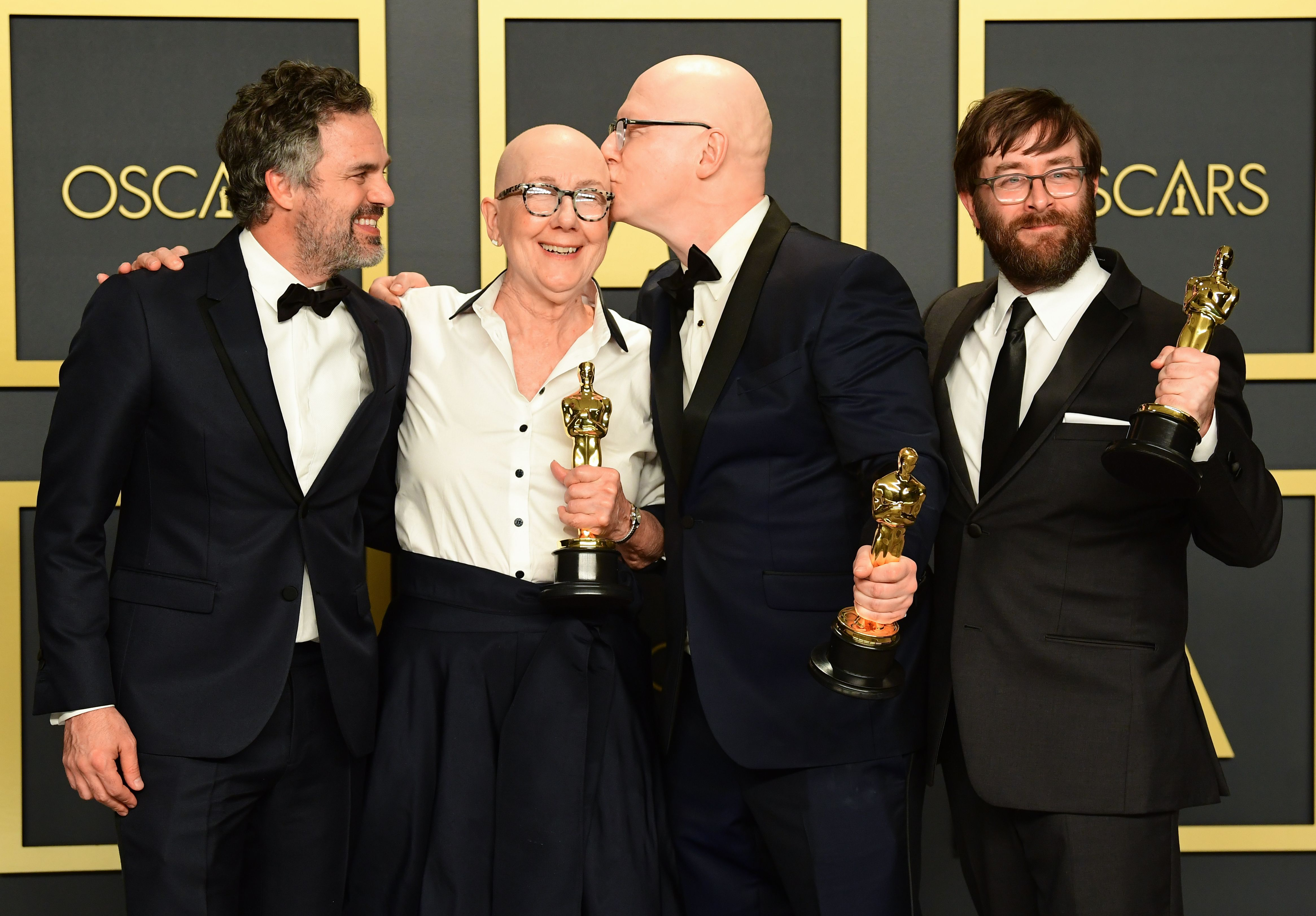 """US directors Julia Reichert, Jeff Reichert (2R) and steven Steven Bognar (R) pose in the press room with the Oscar for Best Documentary Feature for """"American Factory"""" along with US actor Mark Ruffalo (L) during the 92nd Oscars at the Dolby Theater in Hollywood, California on February 9, 2020. (Photo by FREDERIC J. BROWN / AFP) (Photo by FREDERIC J. BROWN/AFP via Getty Images)"""