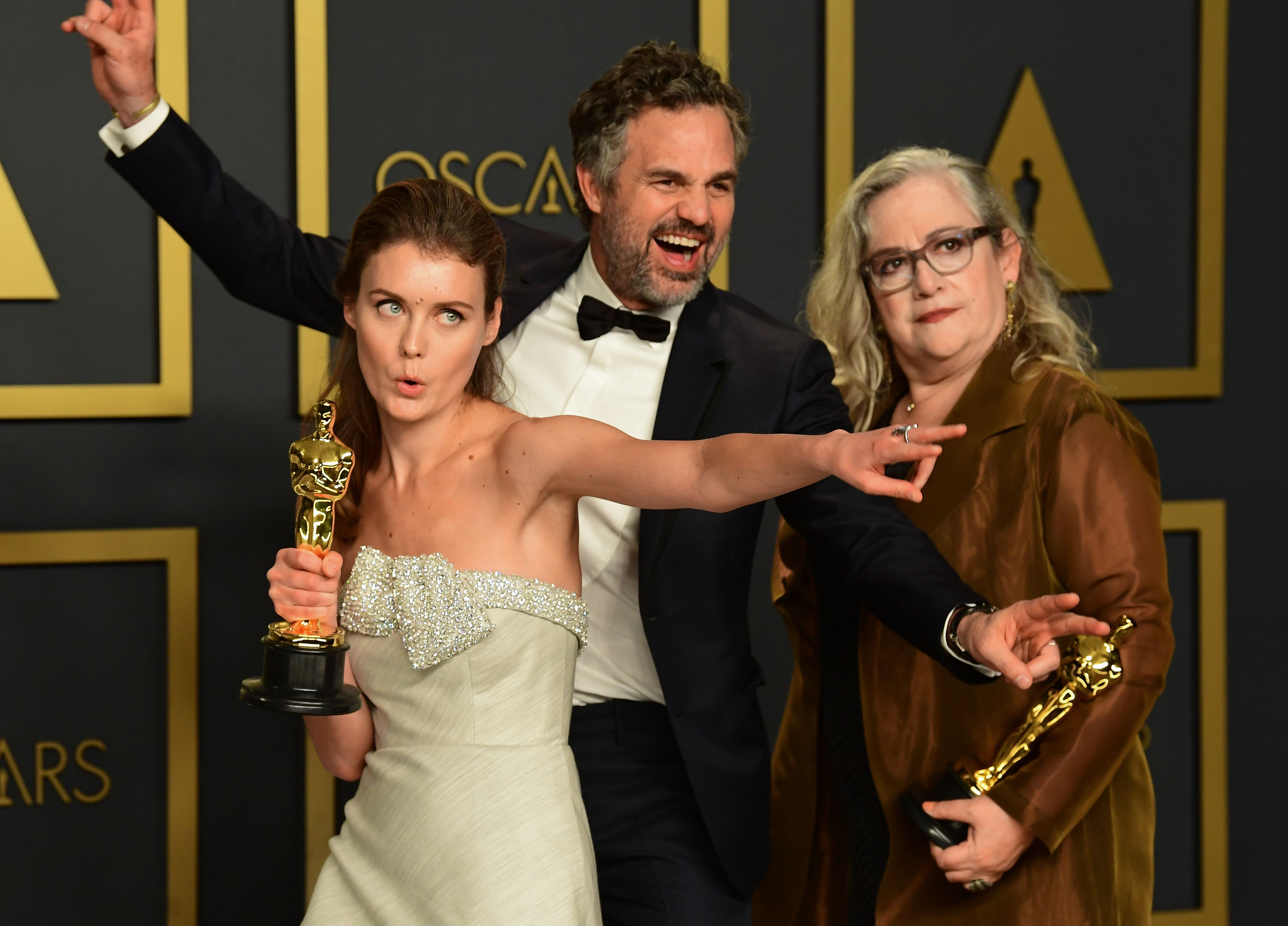 """US filmmaker Carol Dysinger (R) and director Elena Andreicheva (L) poses in the press room with the Oscar for Best Short Subject Documentary for """"Learning to Skateboard in a Warzone (If You're a Girl)"""" along with US actor Mark Ruffalo during the 92nd Oscars at the Dolby Theater in Hollywood, California on February 9, 2020. (Photo by FREDERIC J. BROWN / AFP) (Photo by FREDERIC J. BROWN/AFP via Getty Images)"""
