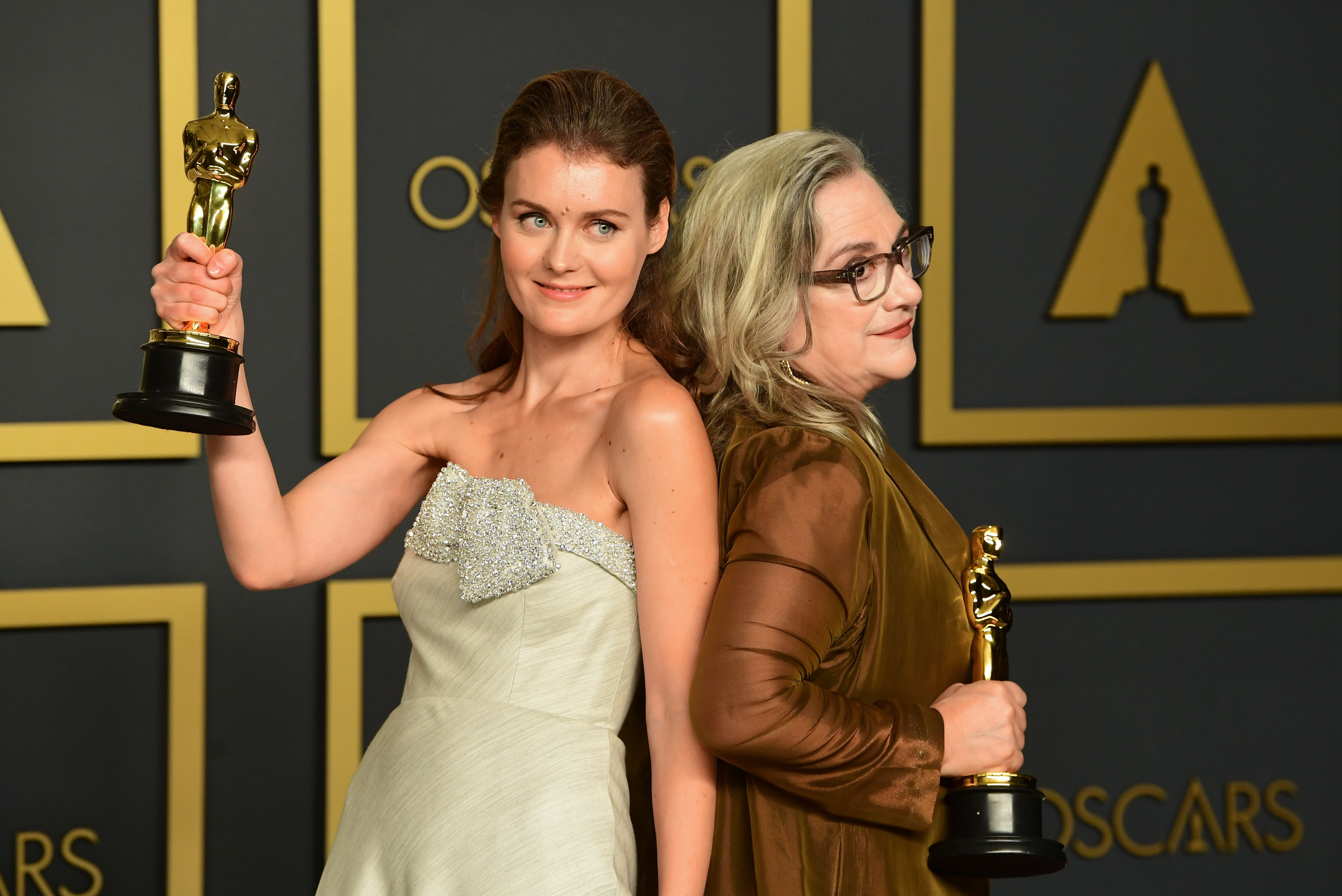 """US filmmaker Carol Dysinger (R) and director Elena Andreicheva (L) pose in the press room with the Oscar for Best Short Subject Documentary for """"Learning to Skateboard in a Warzone (If You're a Girl)"""" during the 92nd Oscars at the Dolby Theater in Hollywood, California on February 9, 2020. (Photo by FREDERIC J. BROWN / AFP) (Photo by FREDERIC J. BROWN/AFP via Getty Images)"""