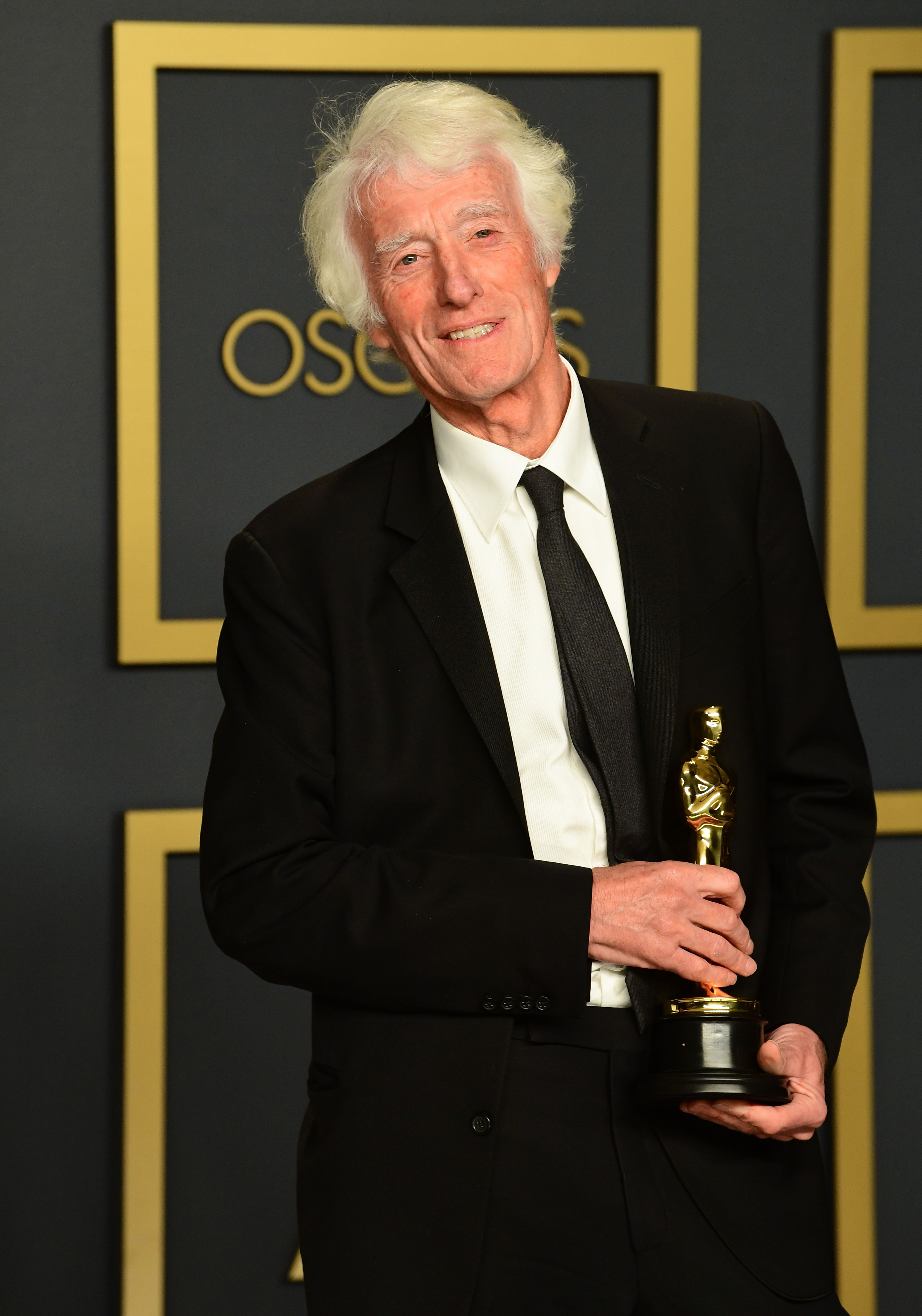 """British cinematographer Roger Deakins poses in the press room with the Oscar for Best Cinematography for """"1917"""" during the 92nd Oscars at the Dolby Theater in Hollywood, California on February 9, 2020. (Photo by FREDERIC J. BROWN / AFP) (Photo by FREDERIC J. BROWN/AFP via Getty Images)"""