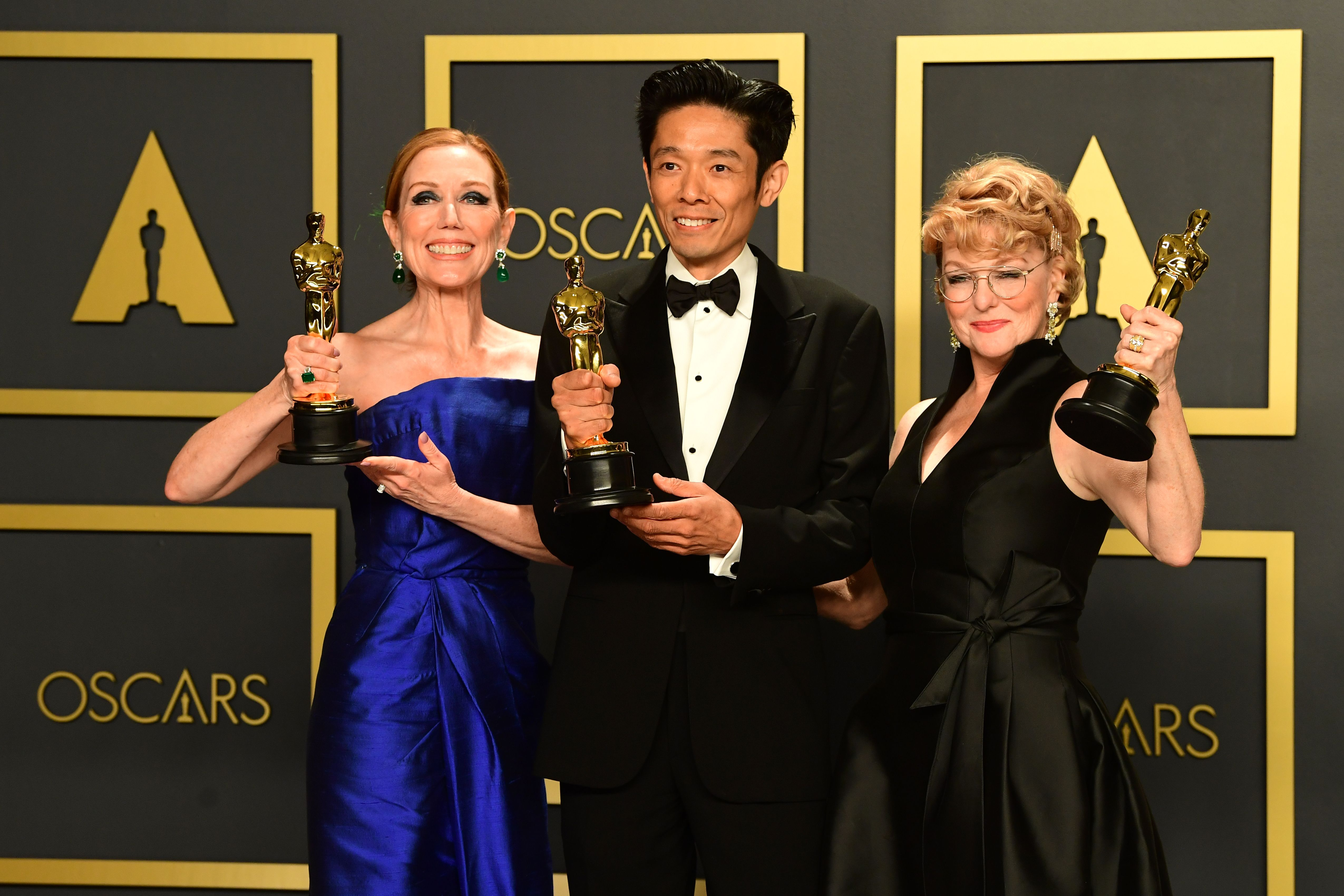 """US-Japanese makeup artist Kazu Hiro (C), US hair stylist Anne Morgan (L) and US makeup artist Vivian Baker pose in the press room with the Oscar for Best Makeup and Hairstyling for """"Bombshell"""" during the 92nd Oscars at the Dolby Theater in Hollywood, California on February 9, 2020. (Photo by FREDERIC J. BROWN / AFP) (Photo by FREDERIC J. BROWN/AFP via Getty Images)"""