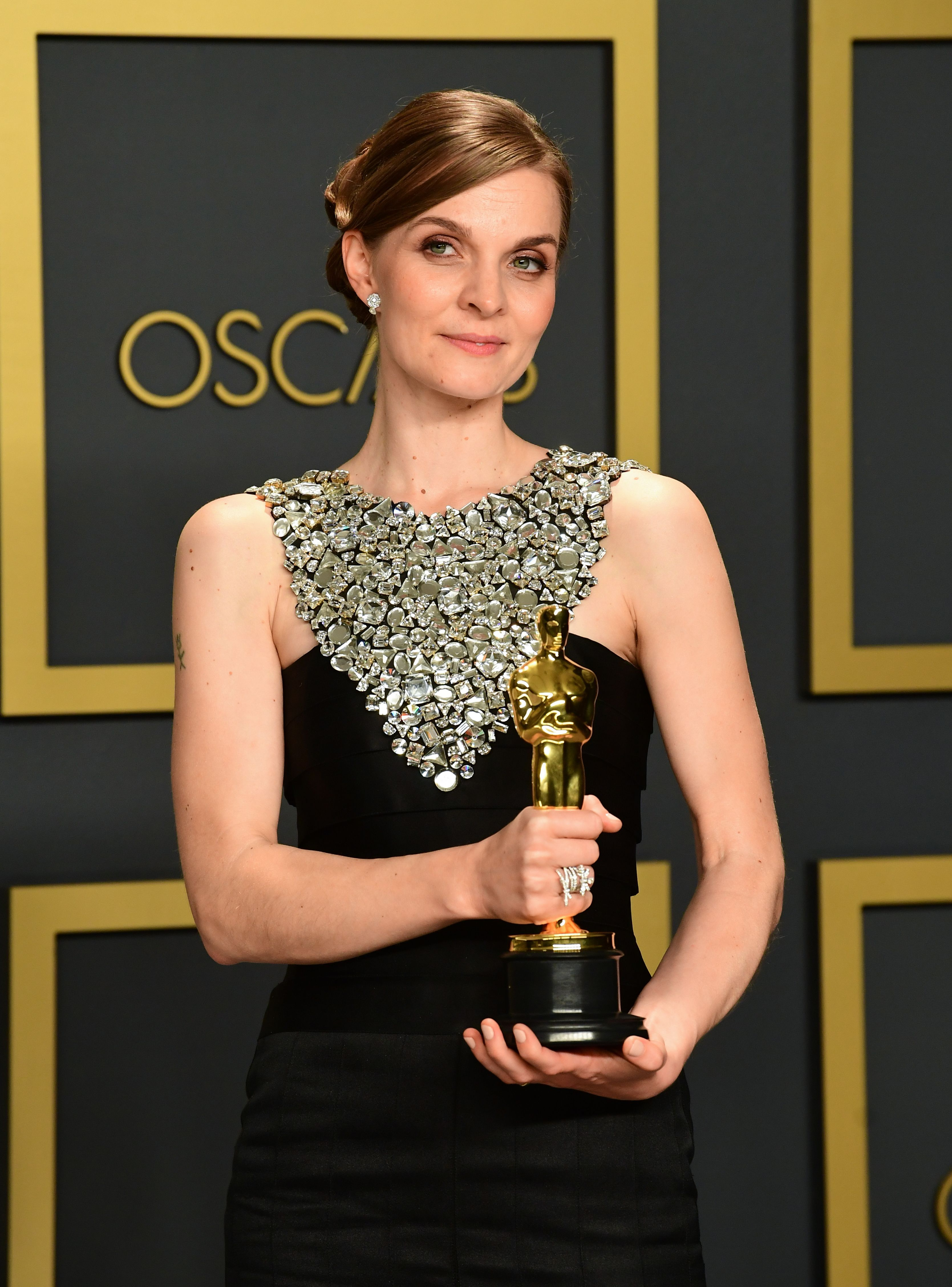 """Icelandic composer Hildur Gudnadottir poses in the press room with the Oscar for Best Original Score for """"Joker"""" during the 92nd Oscars at the Dolby Theater in Hollywood, California on February 9, 2020. (Photo by FREDERIC J. BROWN / AFP) (Photo by FREDERIC J. BROWN/AFP via Getty Images)"""