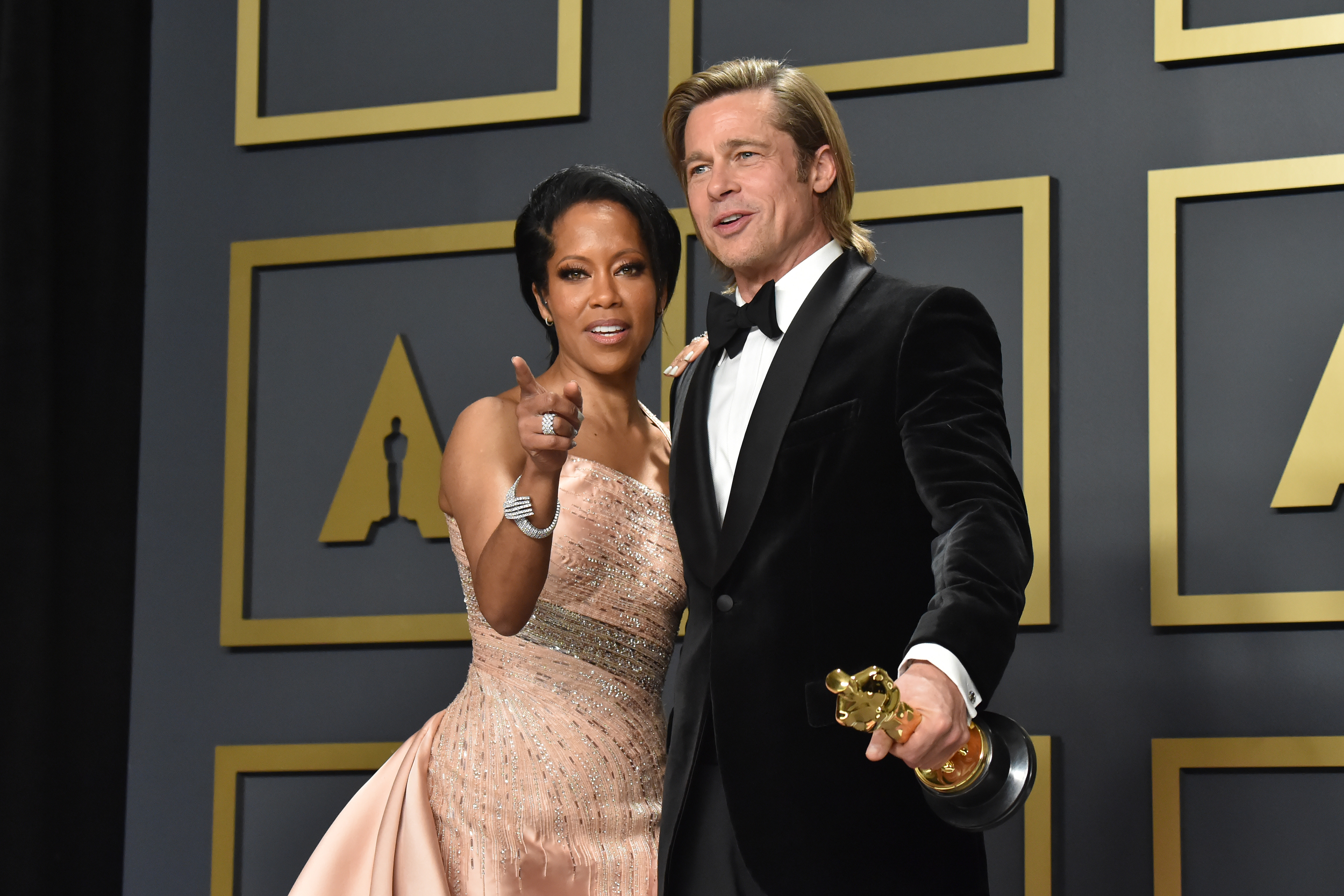 """Regina King and Brad Pitt, winner of the Actor in a Supporting Role award for """"Once Upon a Time…in Hollywood,"""" pose in the press room during the 92nd Annual Academy Awards at Hollywood and Highland on February 09, 2020 in Hollywood, California. (Photo by Jeff Kravitz/FilmMagic)"""