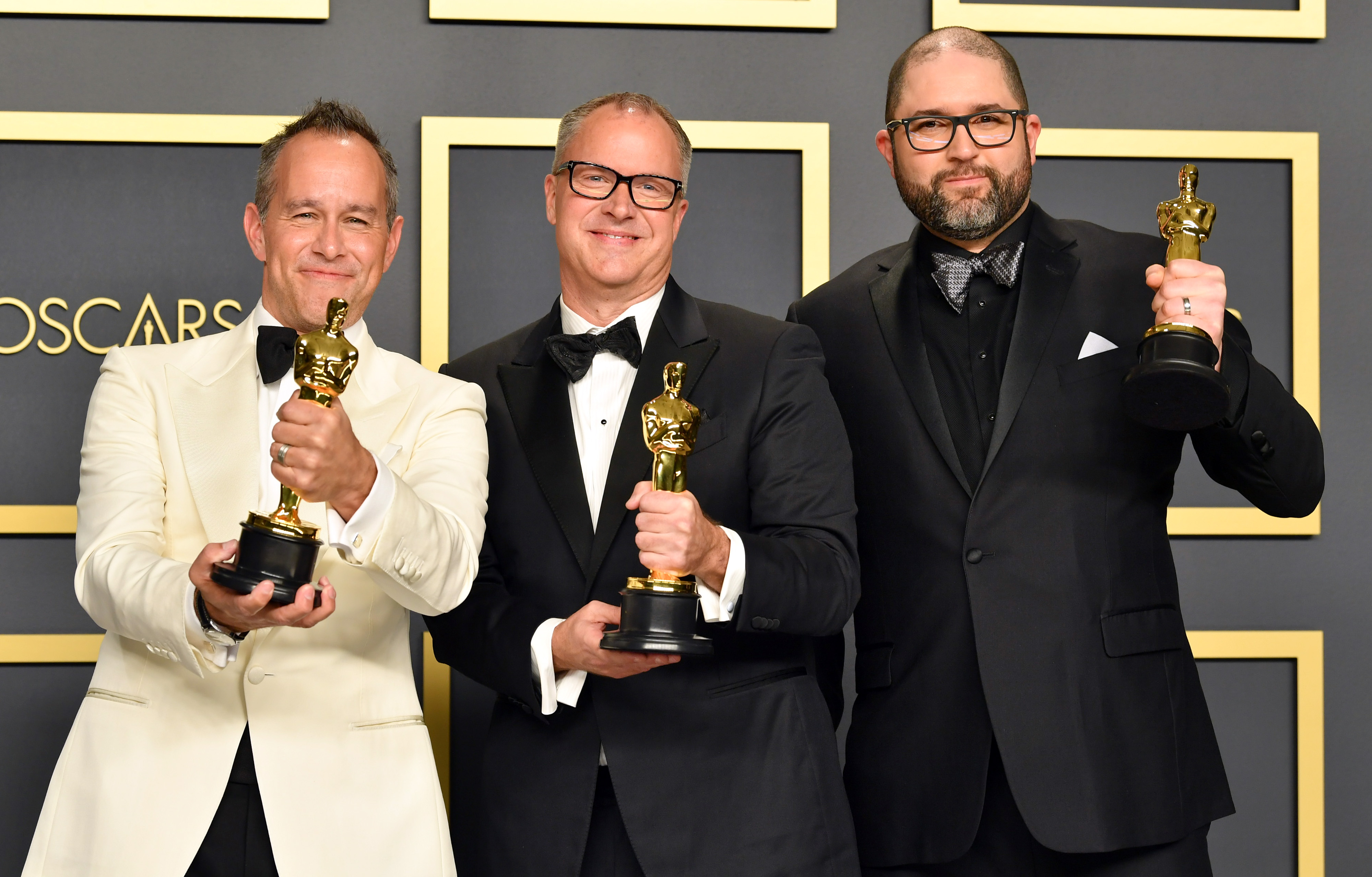 """Filmmakers Jonas Rivera, Mark Nielsen and Josh Cooley, winners of the Animated Feature Film award for """"Toy Story 4,""""  pose in the press room during the 92nd Annual Academy Awards at Hollywood and Highland on February 09, 2020 in Hollywood, California. (Photo by Amy Sussman/Getty Images)"""