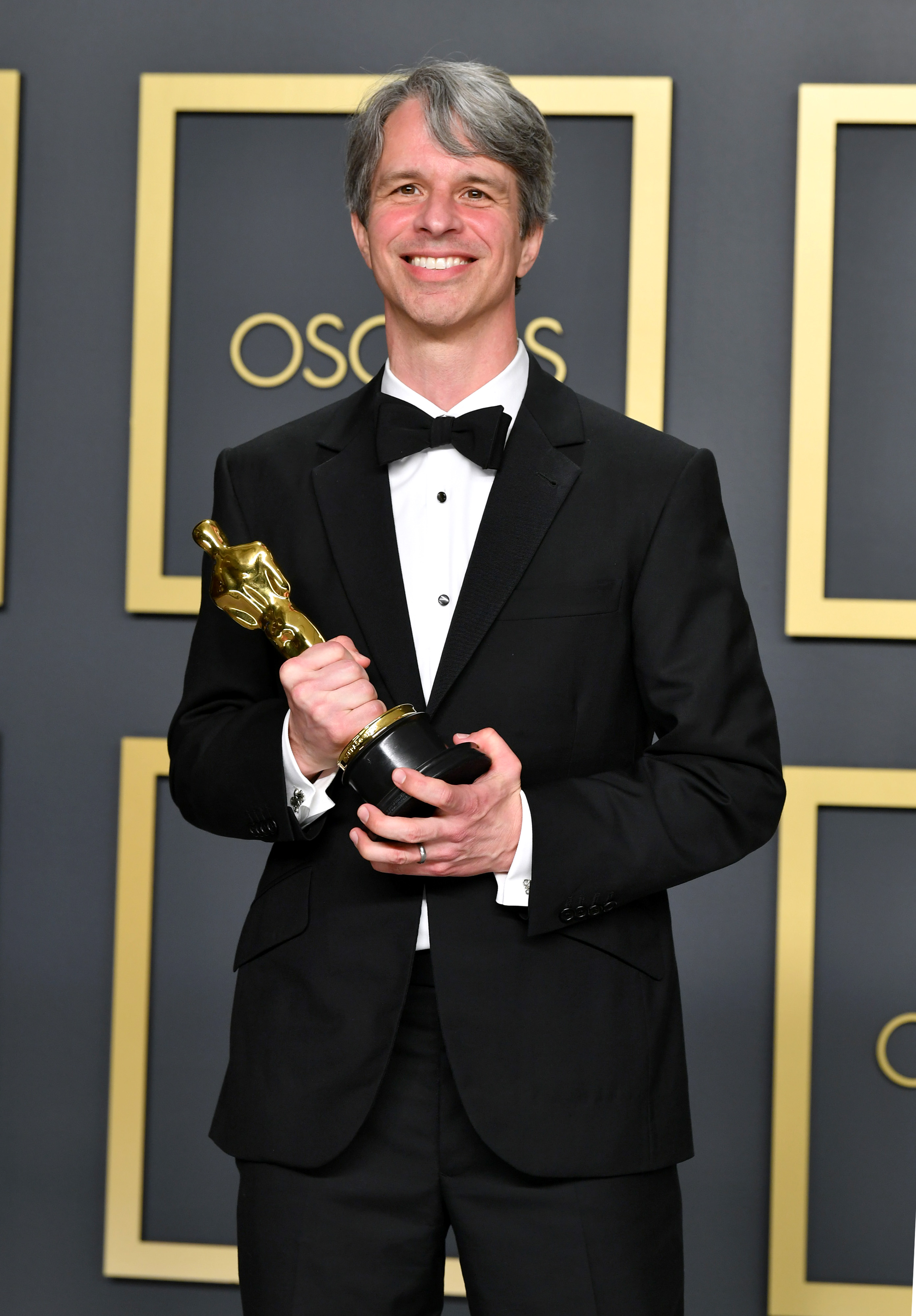 """Director Marshall Curry, winner of the Live Action Short Film award for """"The Neighbors' Window,"""" poses in the press room during the 92nd Annual Academy Awards at Hollywood and Highland on February 09, 2020 in Hollywood, California. (Photo by Amy Sussman/Getty Images)"""