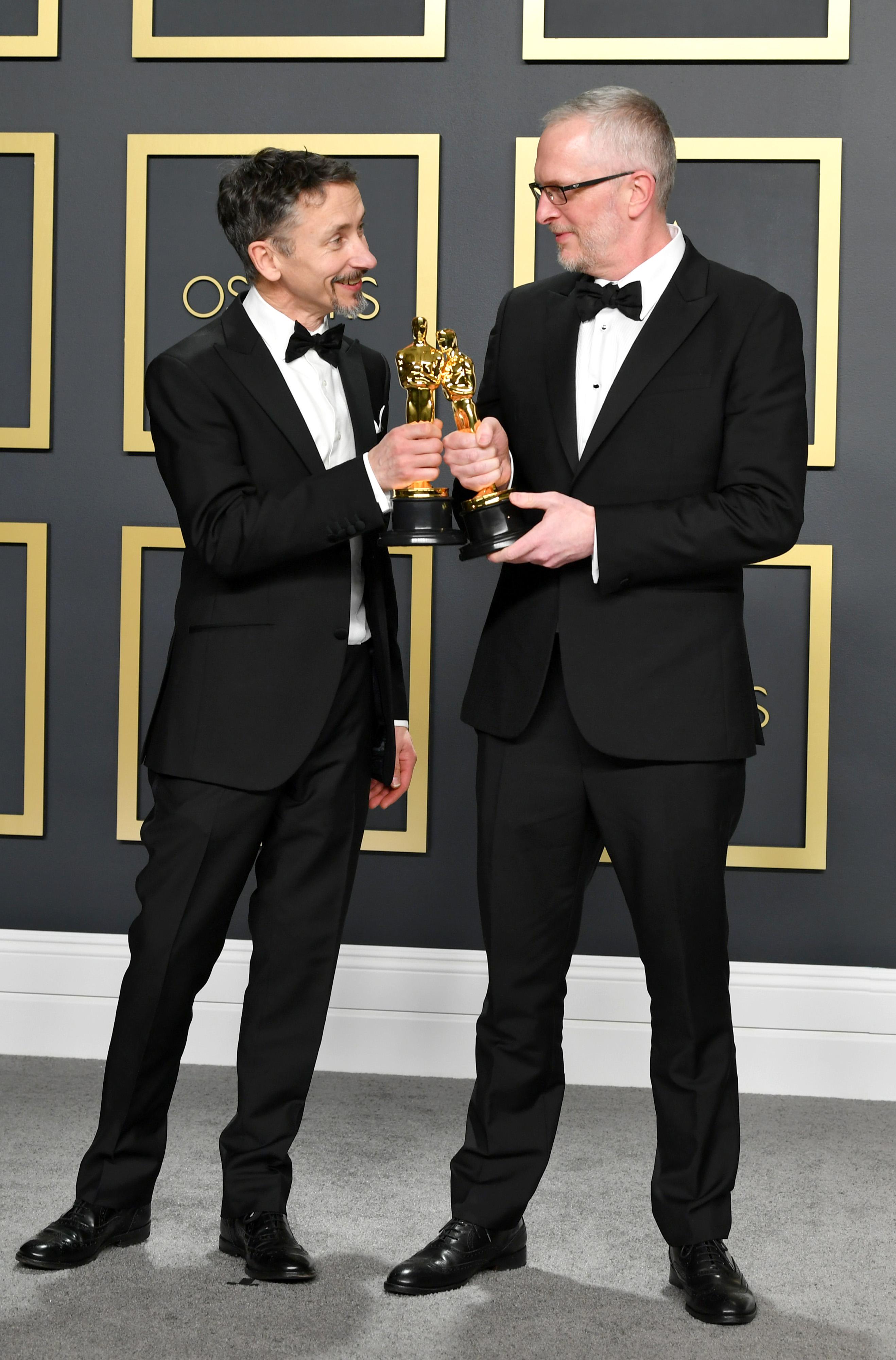 """Sound editors Mark Taylor and Stuart Wilson, winners of the Sound Mixing award for """"1917,""""  pose in the press room during the 92nd Annual Academy Awards at Hollywood and Highland on February 09, 2020 in Hollywood, California. (Photo by Amy Sussman/Getty Images)"""