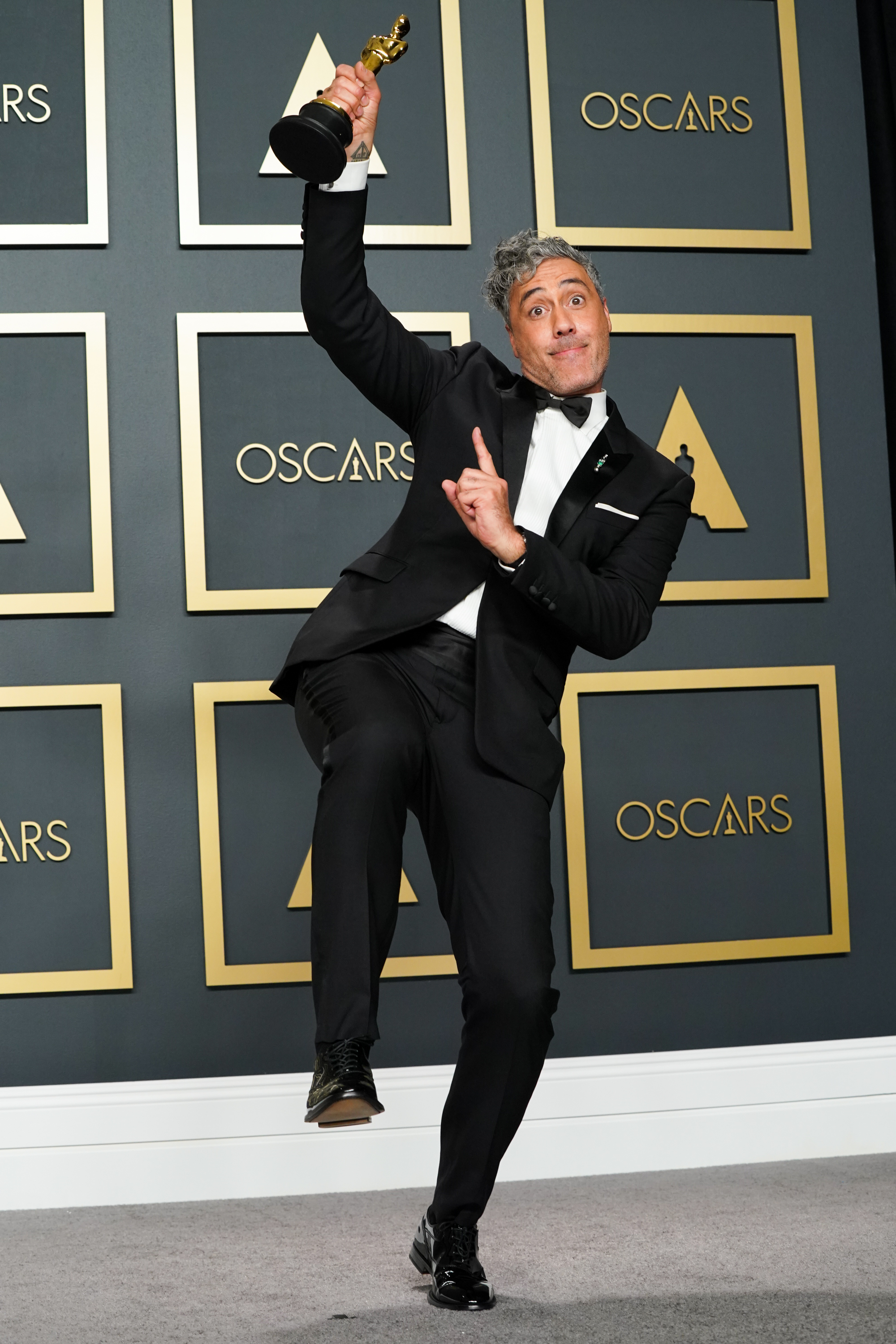 """Taika Waititi, winner of Best Adapted Screenplay for """"Jojo Rabbit,"""" poses in the press room during the 92nd Annual Academy Awards at Hollywood and Highland on February 09, 2020 in Hollywood, California. (Photo by Rachel Luna/Getty Images)"""