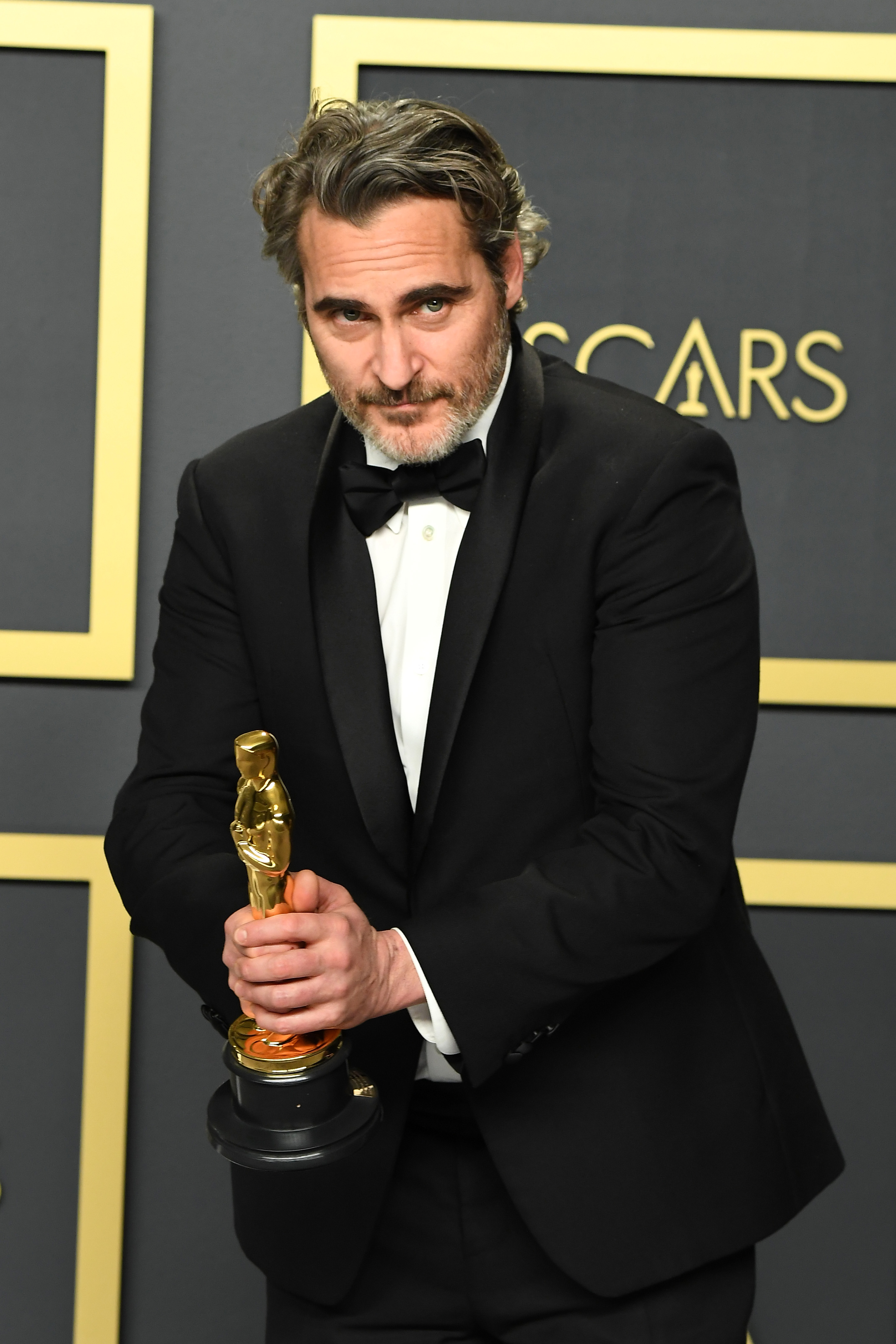 """Joaquin Phoenix, winner of the Actor in a Leading Role award for """"Joker,"""" poses in the press room during poses in the press room during the 92nd Annual Academy Awards at Hollywood and Highland on February 09, 2020 in Hollywood, California. (Photo by Steve Granitz/WireImage )"""