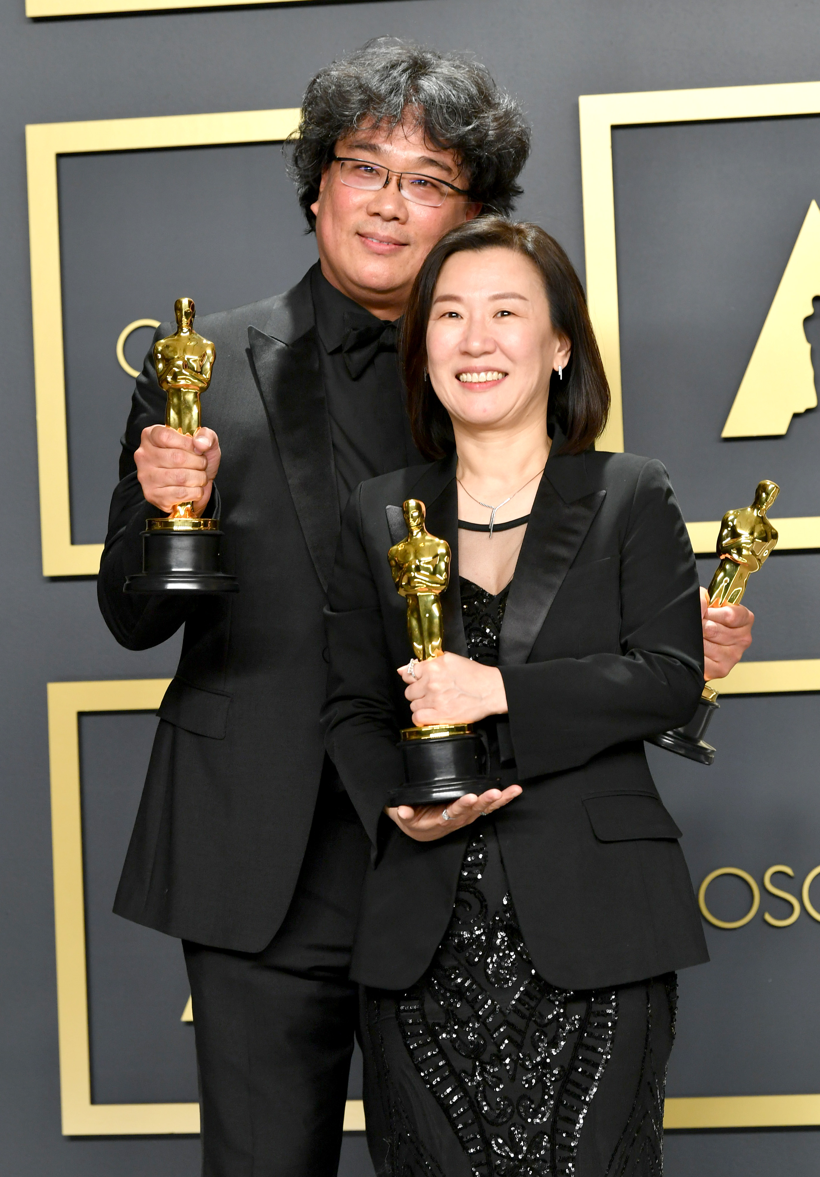 """Director Bong Joon-ho and producer Kwak Sin-ae, winners of the Original Screenplay, International Feature Film, Directing, and Best Picture awards for """"Parasite,""""  pose in the press room during the 92nd Annual Academy Awards at Hollywood and Highland on February 09, 2020 in Hollywood, California. (Photo by Amy Sussman/Getty Images)"""