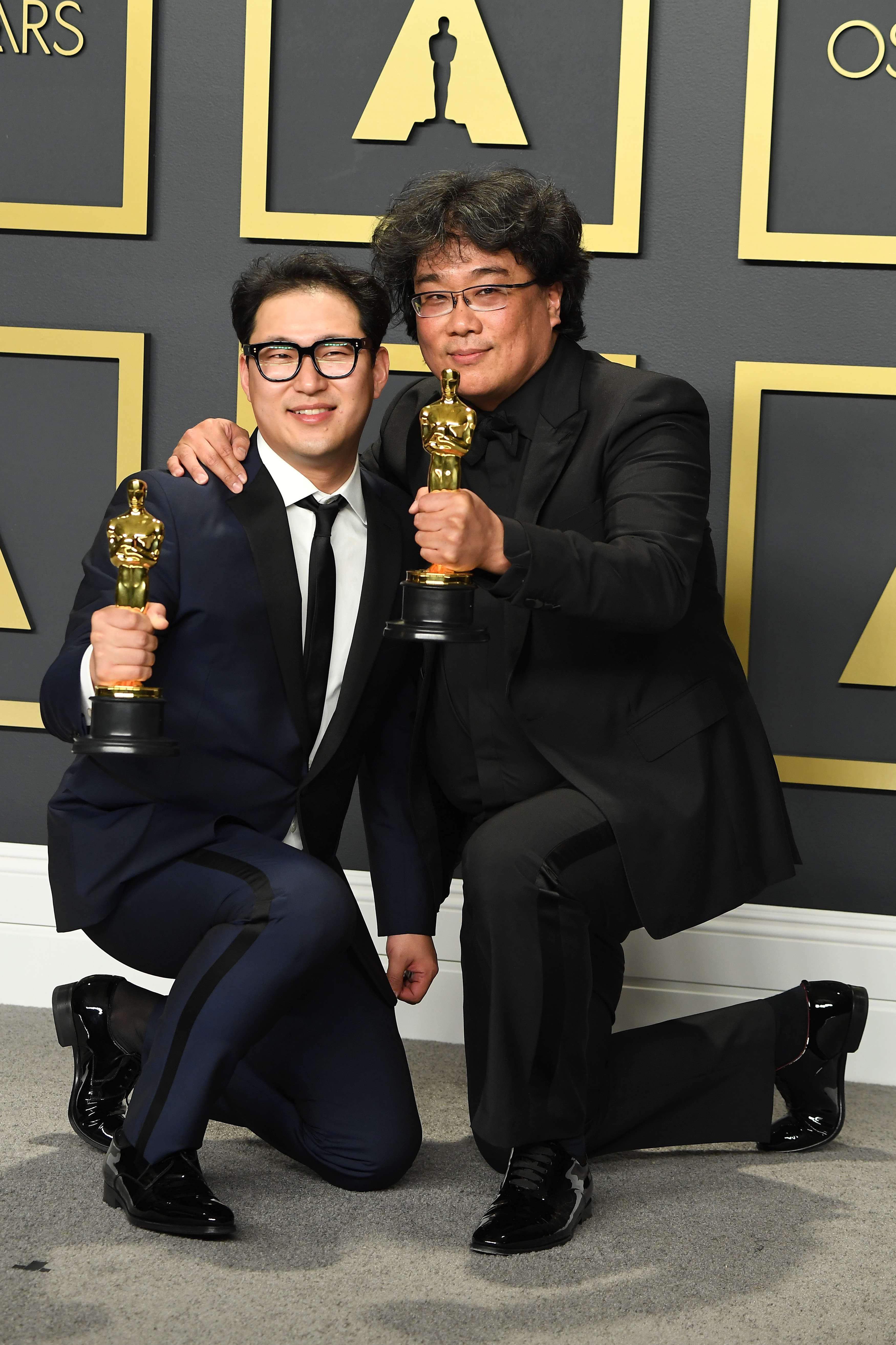 """Bong Joon-ho (R) and  Han Jin-won, winners of the Original Screenplay award for """"Parasite,""""  poses in the press room during the 92nd Annual Academy Awards at Hollywood and Highland on February 09, 2020 in Hollywood, California. (Photo by Steve Granitz/WireImage )"""