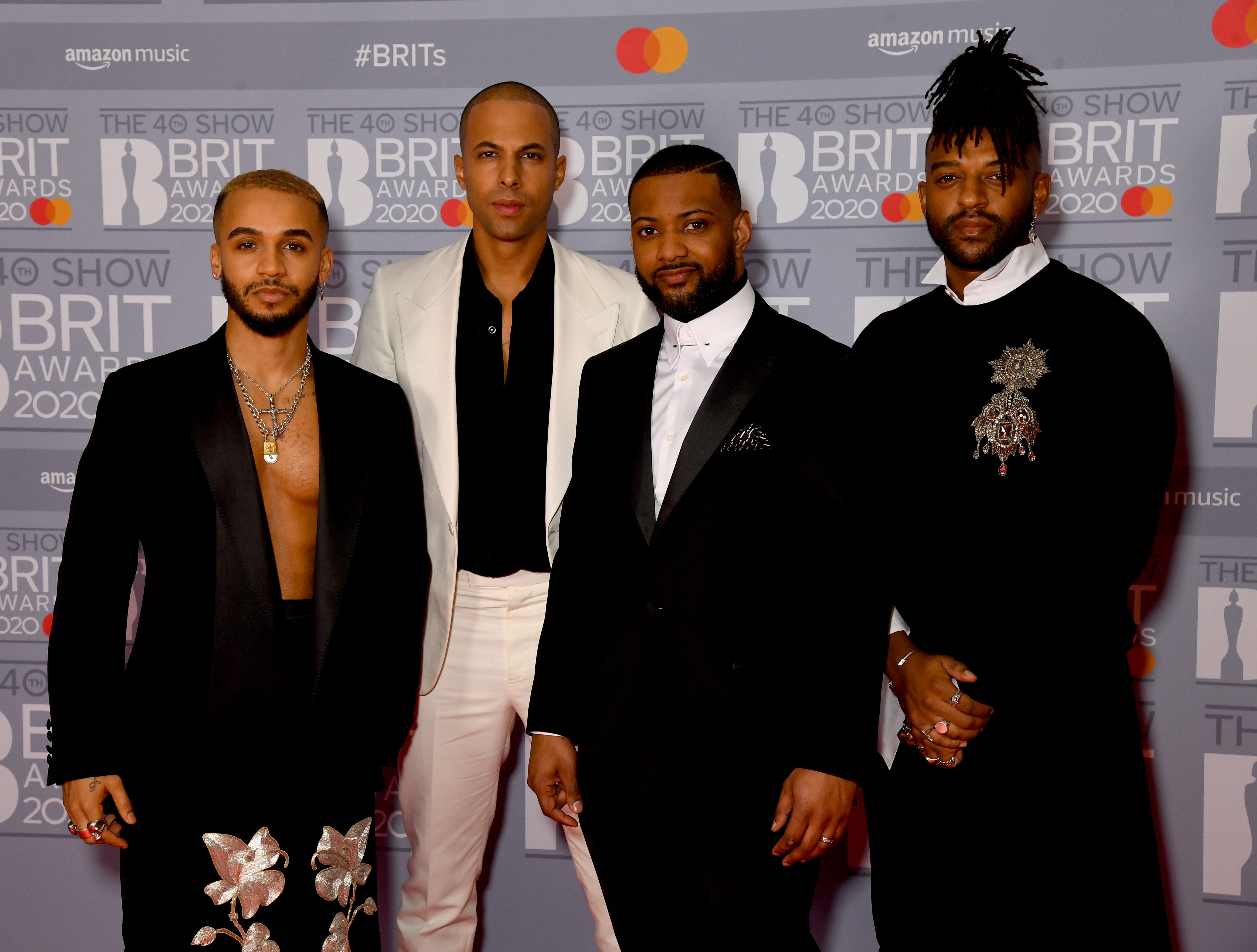 (L to R) Aston Merrygold, Marvin Humes, JB Gill and Oritse Williams of JLS attend The BRIT Awards 2020 at The O2 Arena on February 18, 2020 in London, England. (Photo by Dave J Hogan/Getty Images)