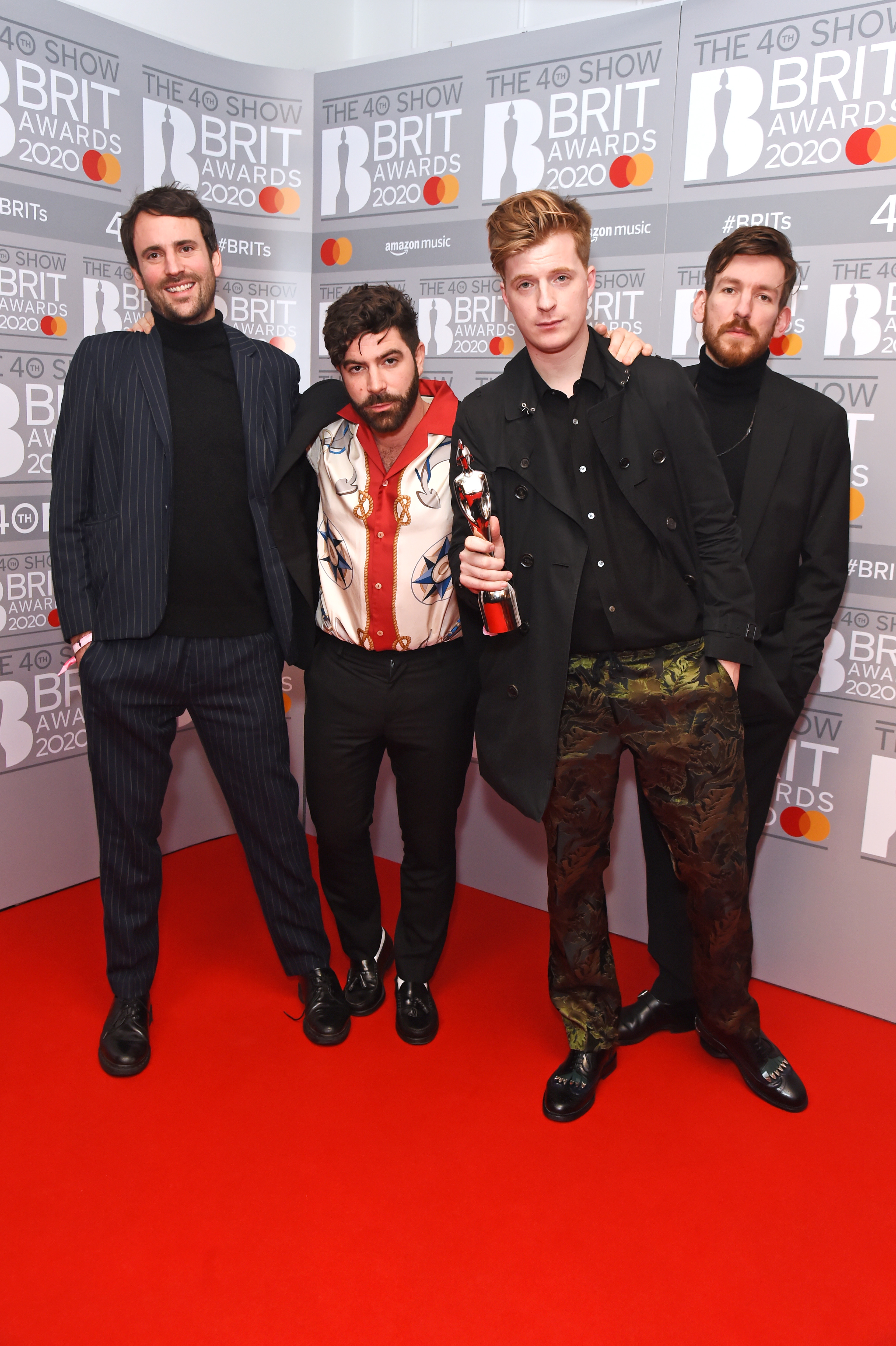 (L to R) Jimmy Smith, Yannis Philippakis, Jack Bevan and Edwin Congreave of Foals, winners of the Group Of The Year award, pose in the winners room at The BRIT Awards 2020 at The O2 Arena on February 18, 2020 in London, England.  (Photo by David M. Benett/Dave Benett/Getty Images)