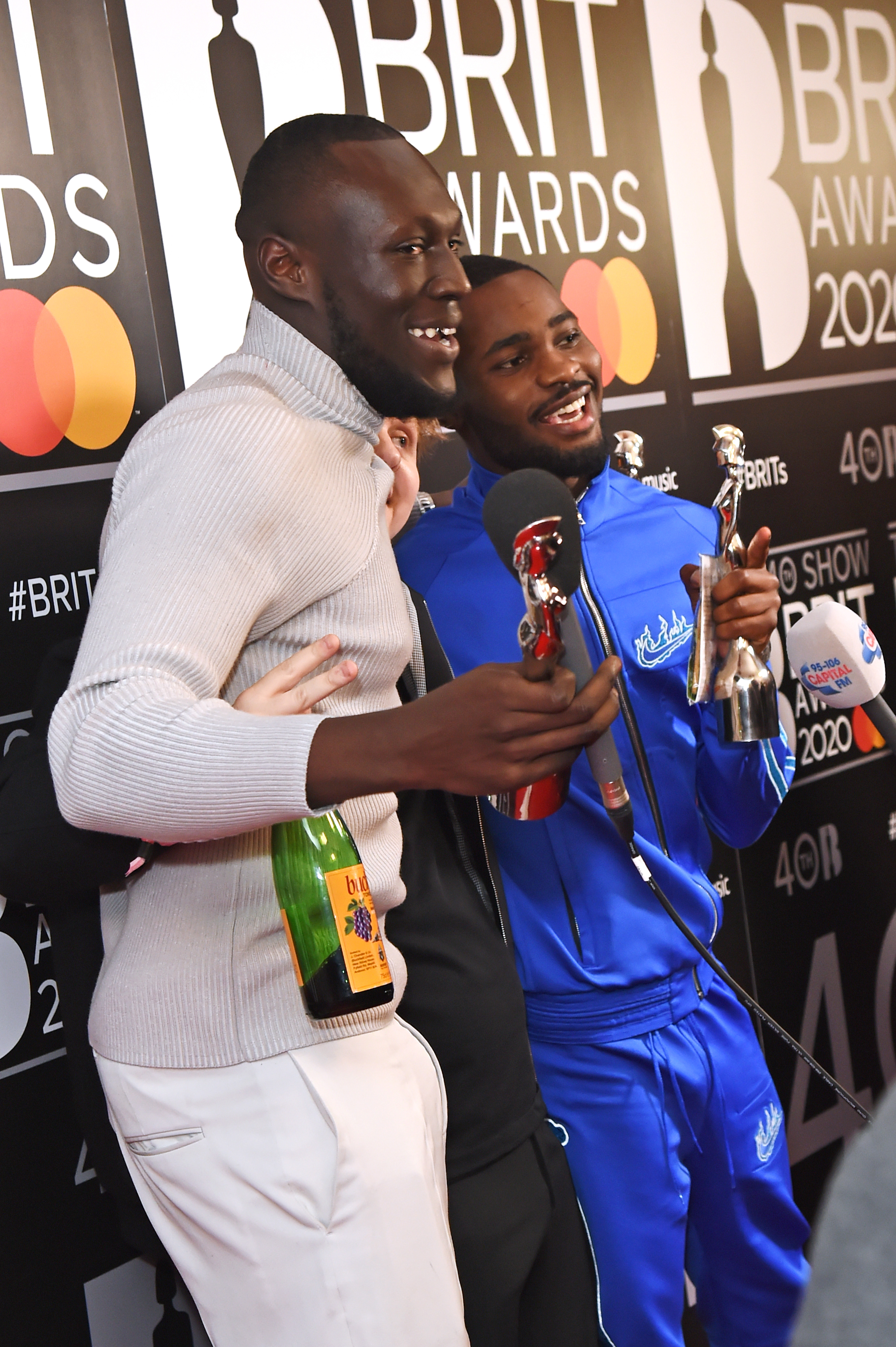 (L to R) Lewis Capaldi, winner of the Best New Artist and Song Of The Year awards, Stormzy, winner of the Male Solo Artist award, and Dave, winner of the Mastercard Album Of The Year award, pose in the winners room at The BRIT Awards 2020 at The O2 Arena on February 18, 2020 in London, England.  (Photo by David M. Benett/Dave Benett/Getty Images)